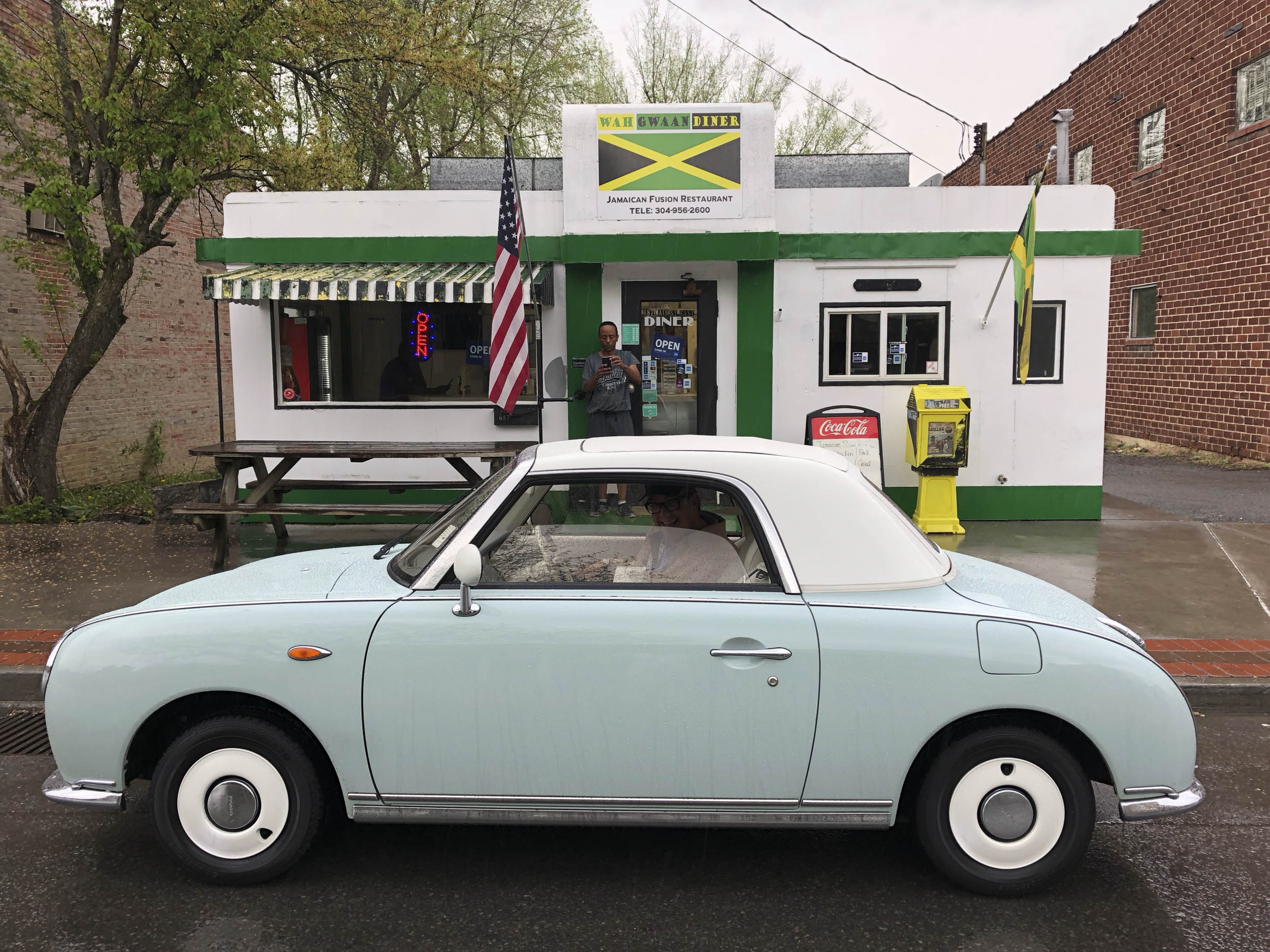 Larry Printz driving a 1991 Nissan Figaro around town