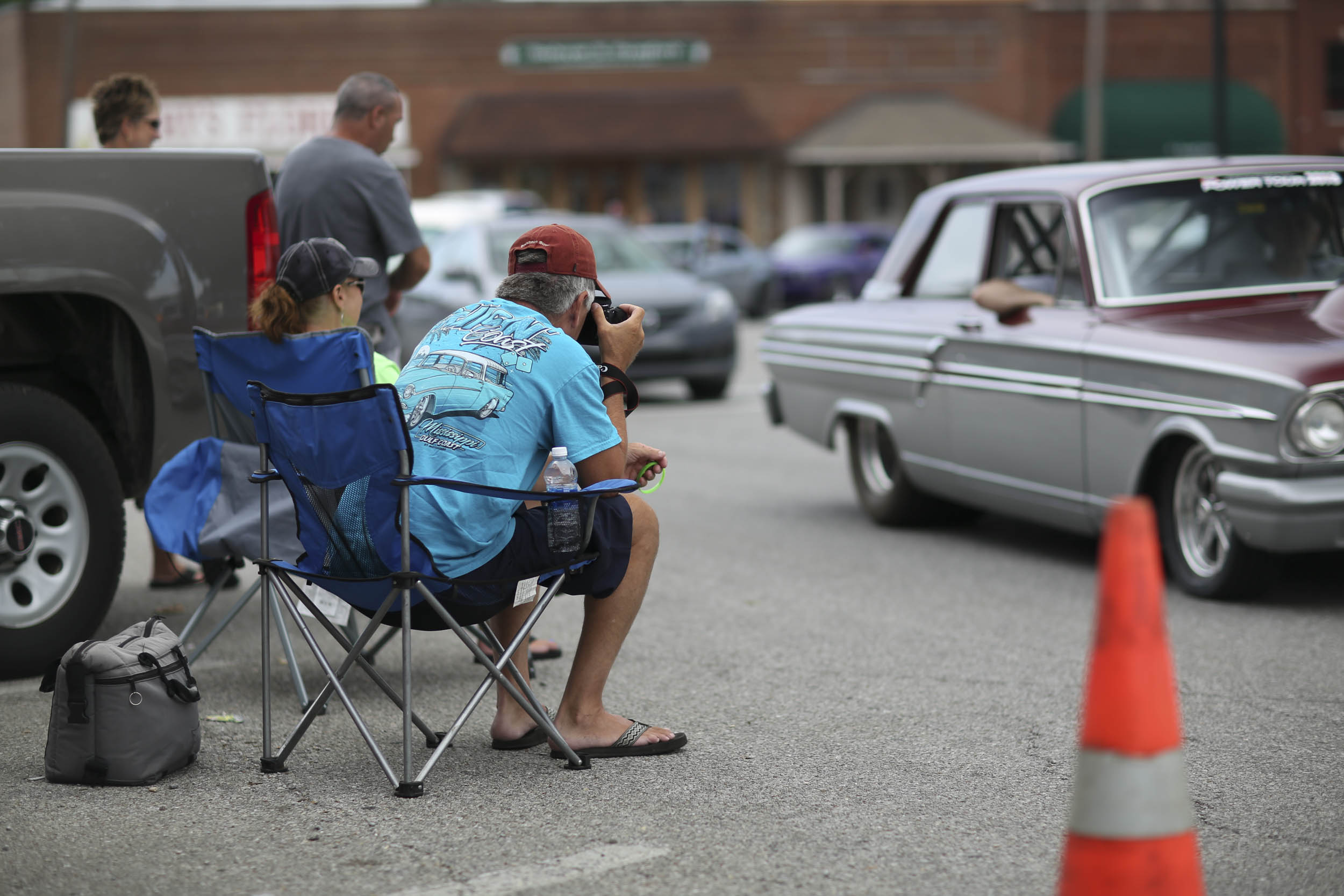 Many of the local residents set up at an intersection to take in the constant parade of cars.