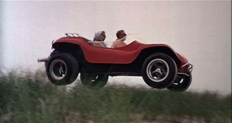 "Steve McQueen driving the Queen Manx buggy from ""The Thomas Crown Affair"""