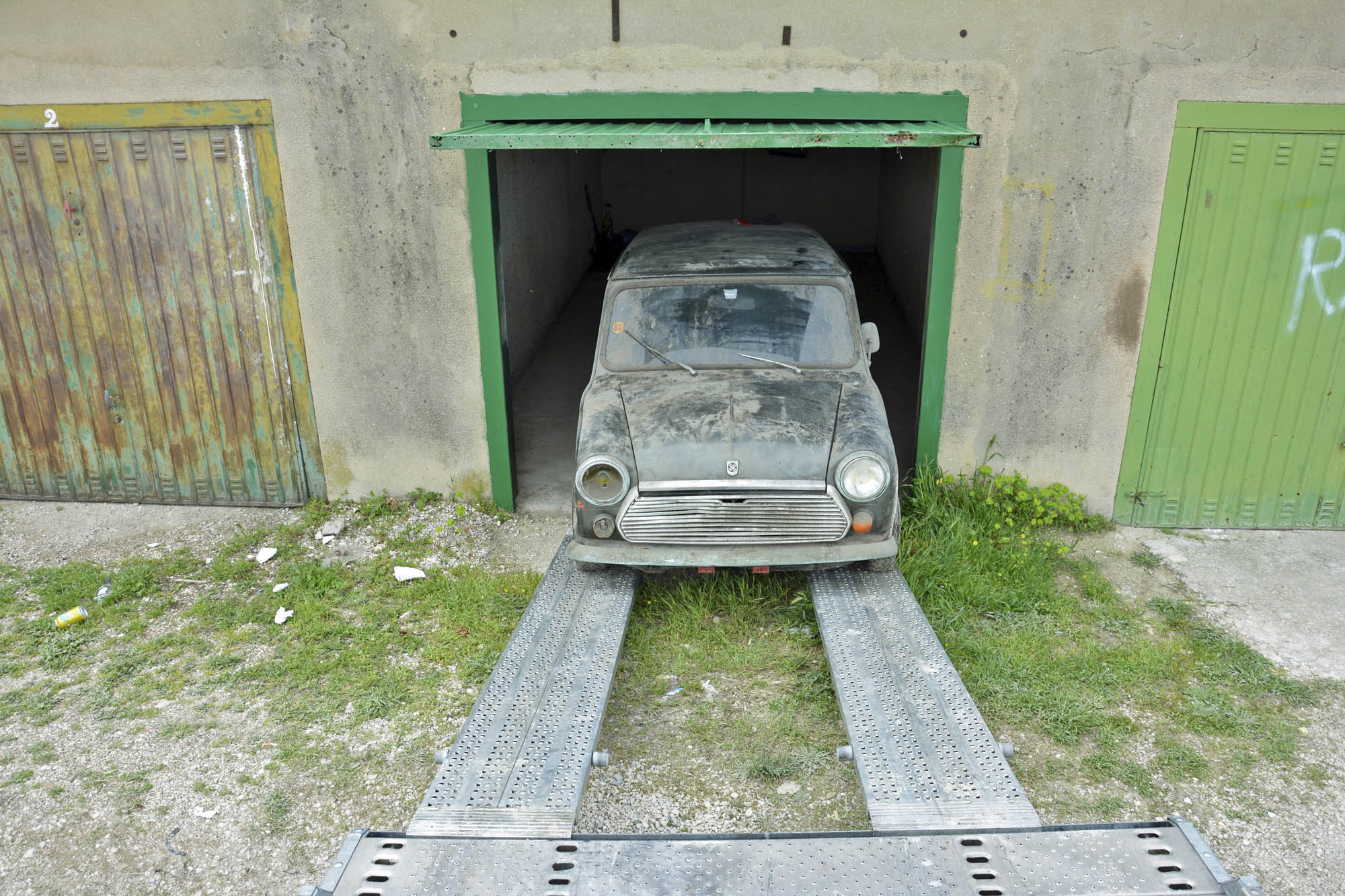 1972 Mini coming out of old Citroen parts store