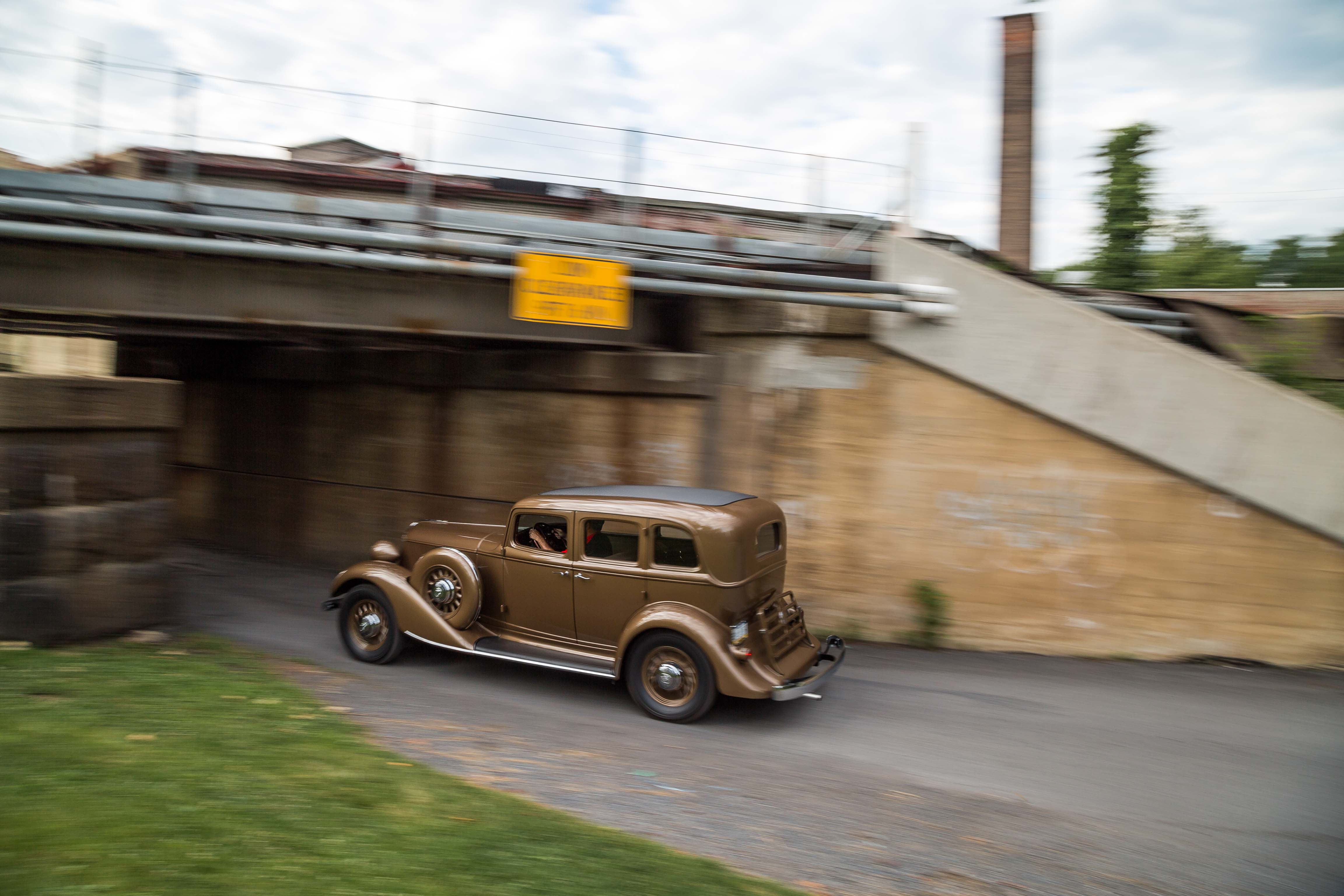 1932 Graham Blue Streak going under bridge