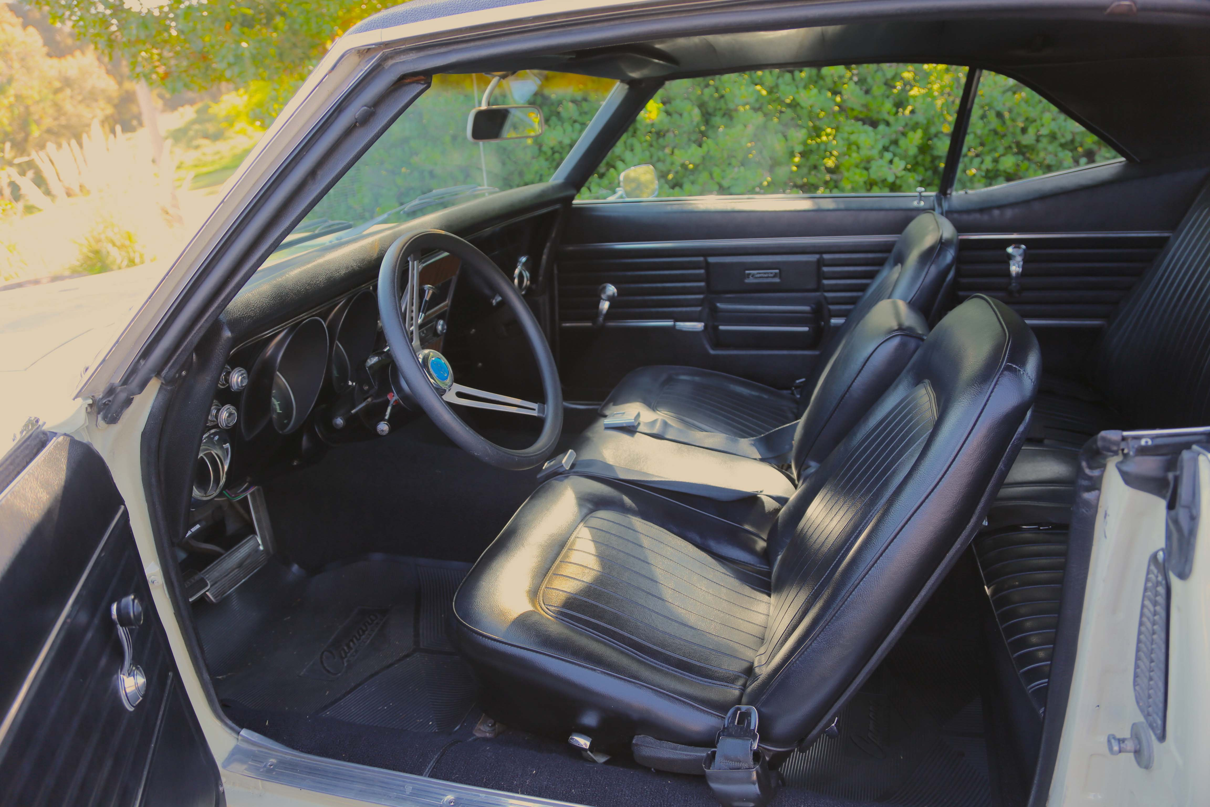 """There's the rare Strato-Back bench seat, and the equally rare """"Comfortilt"""" column. The aftermarket steering wheel is one of the few non-stock items on the Camaro."""