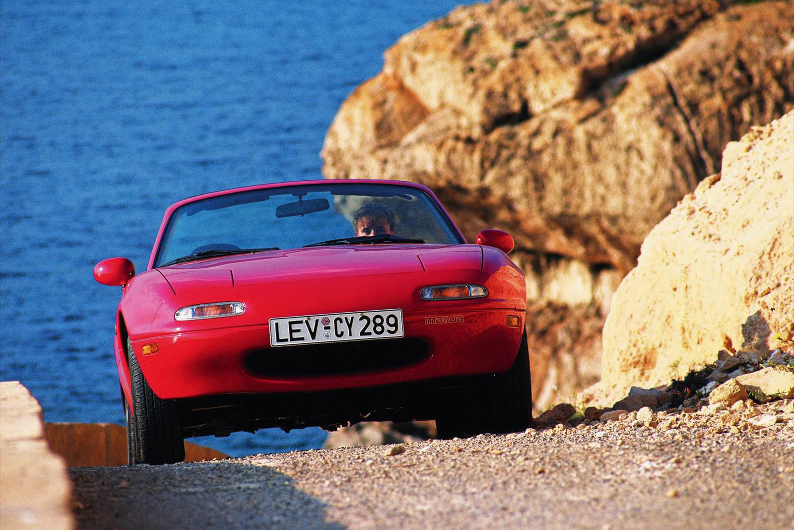 1990 Mazda MX-5 Miata red cliff