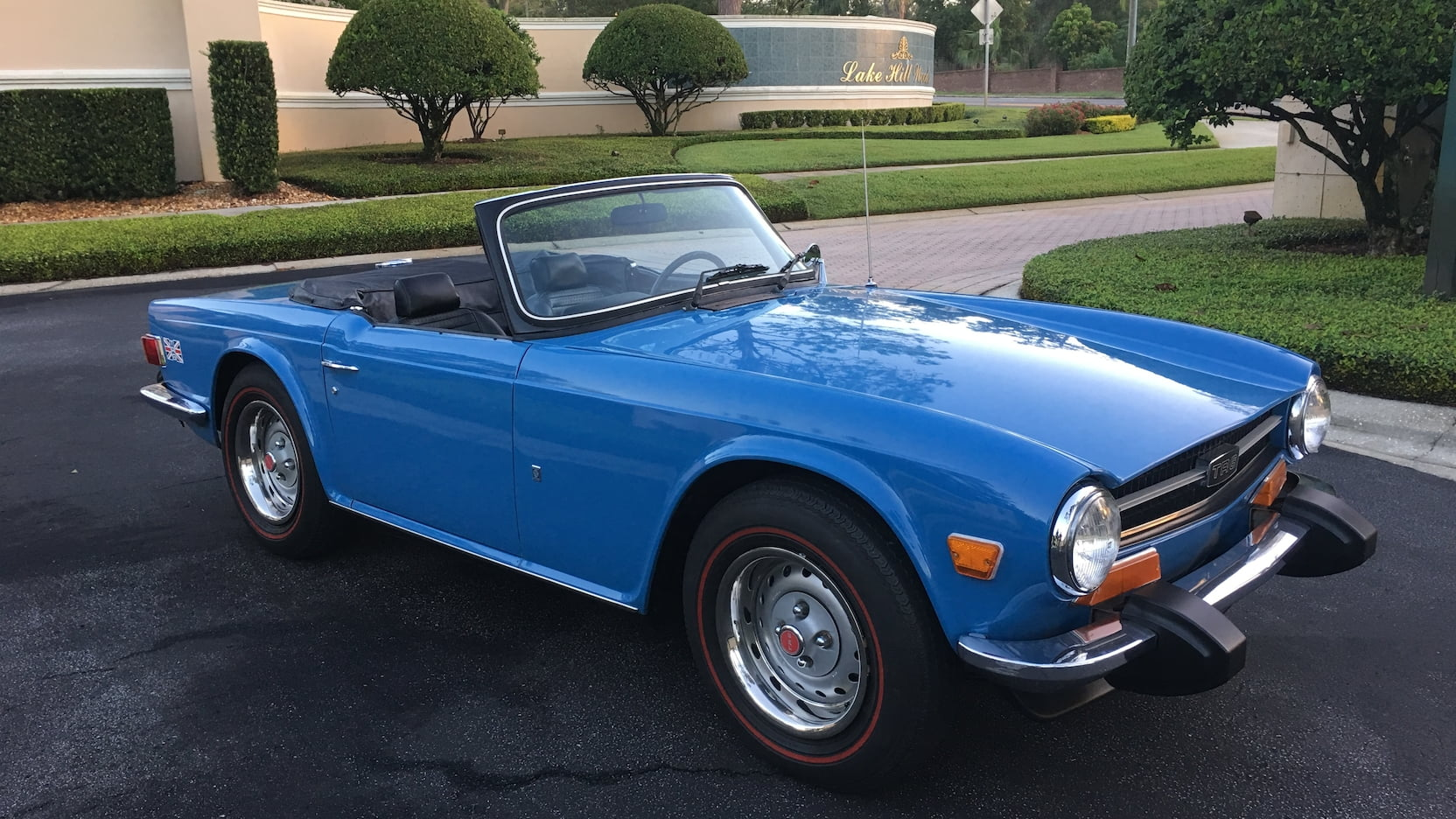 1974 Triumph TR6 Blue green grass and trees