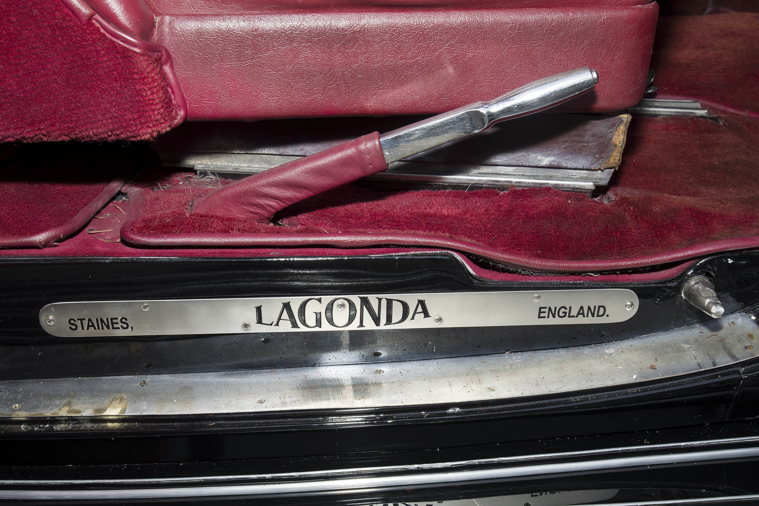 The kickplate below the front doors acknowledges the Staines, England location of the pre-war Lagonda factory.