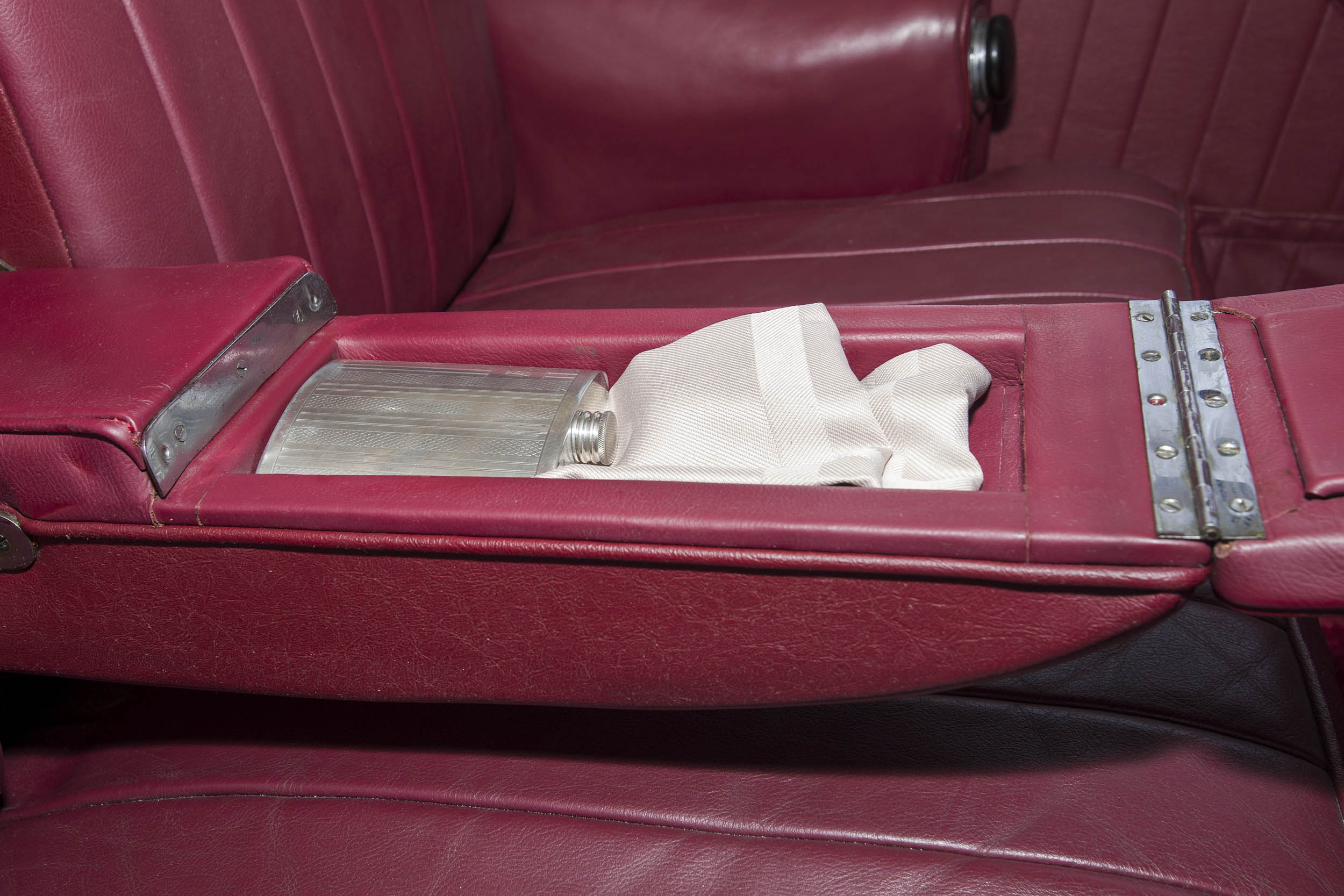 Factory literature specified that the pulldown center console in the rear seat was meant to hold an emergency kit. David Dagostino is quite sure that a flask of fine whisky is what the Lagonda's creators had in mind.
