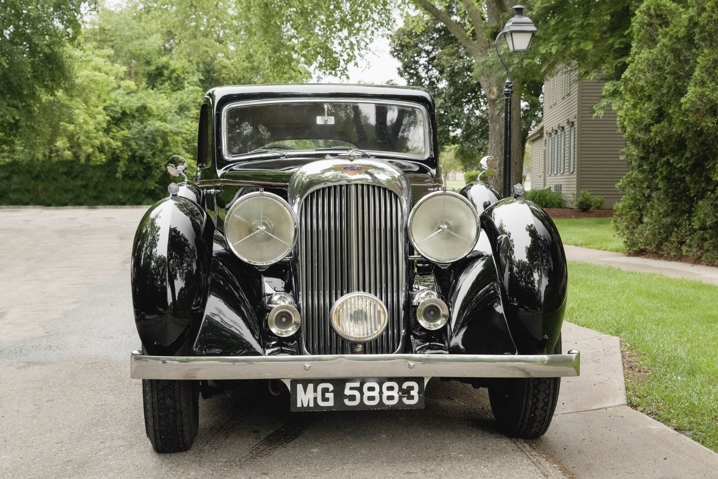 Huge headlamps, a fog light, chrome horns, and a vertical grille can make any lover of pre-war British luxury cars swoon.