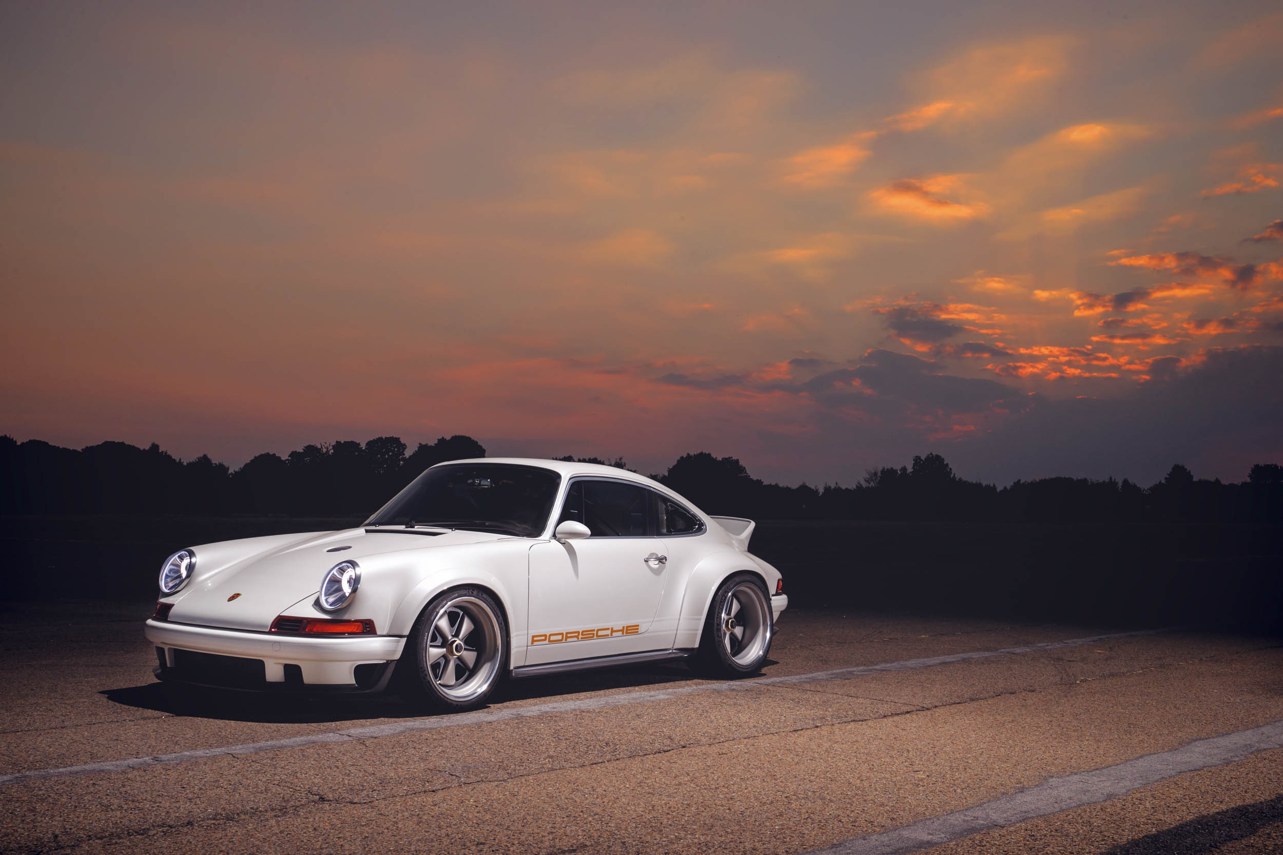 1990 Porsche 911 (964), reimagined by Singer front 3/4 at sunset