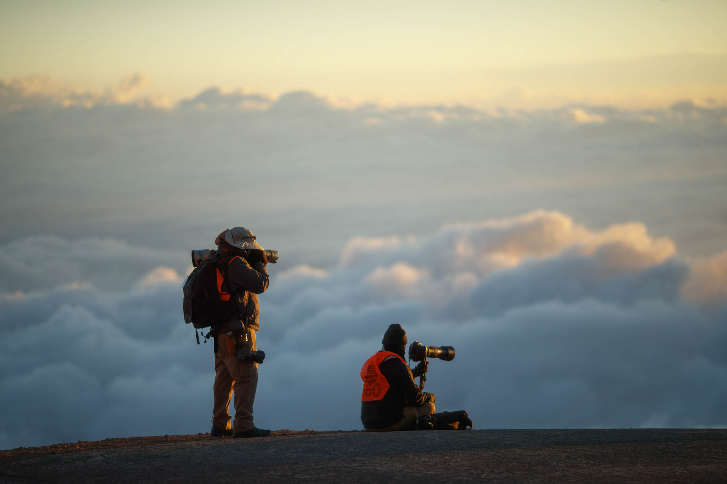 photographers shooting cars climbing Pikes Peak