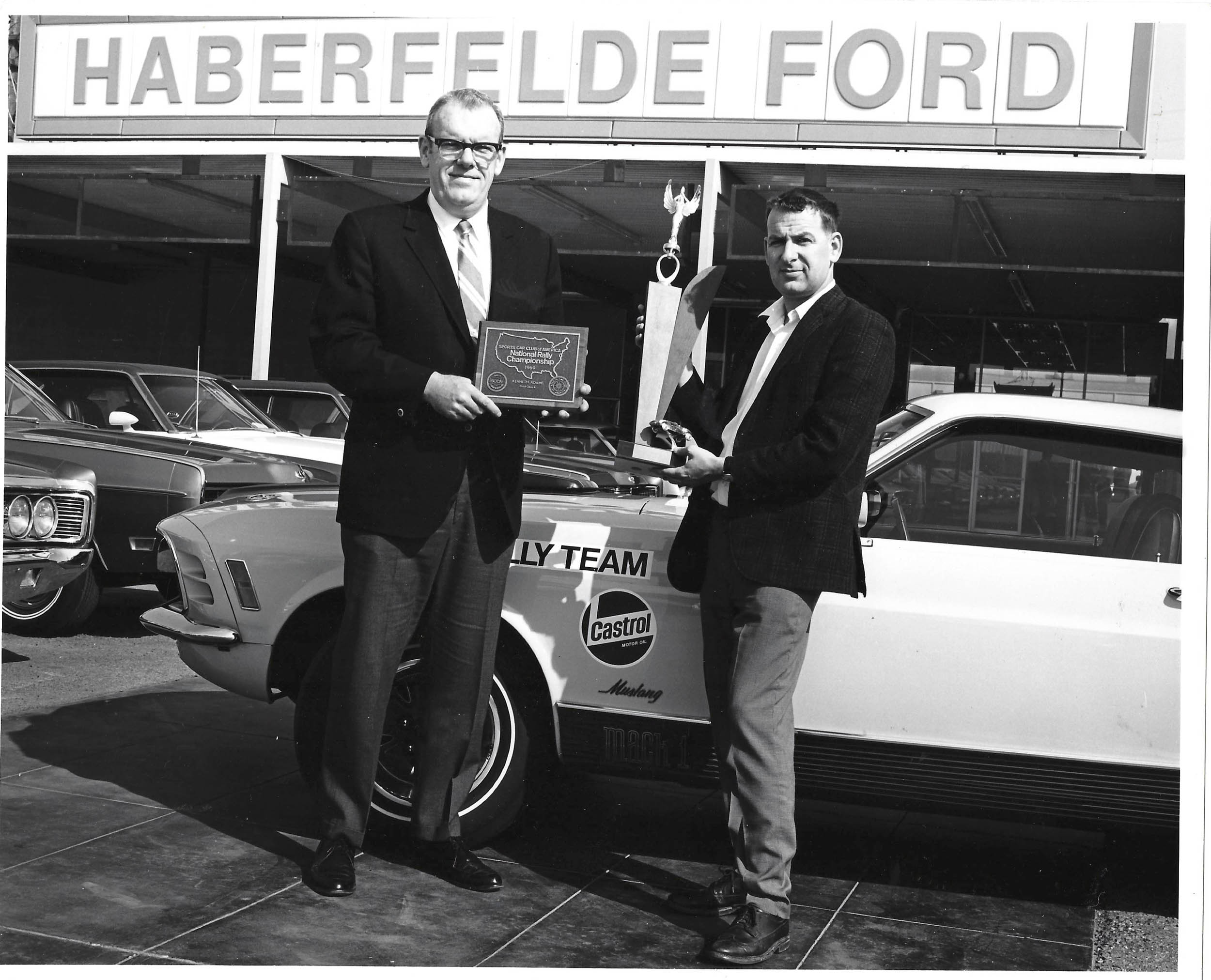 Jim Burke of Haberfelde Ford in Bakersfield, CA (now Burke Ford) presents Ken Adams with trophy for being part of Ford's winning the 1970 SCCA Manufacturer's Road Rally Championship.