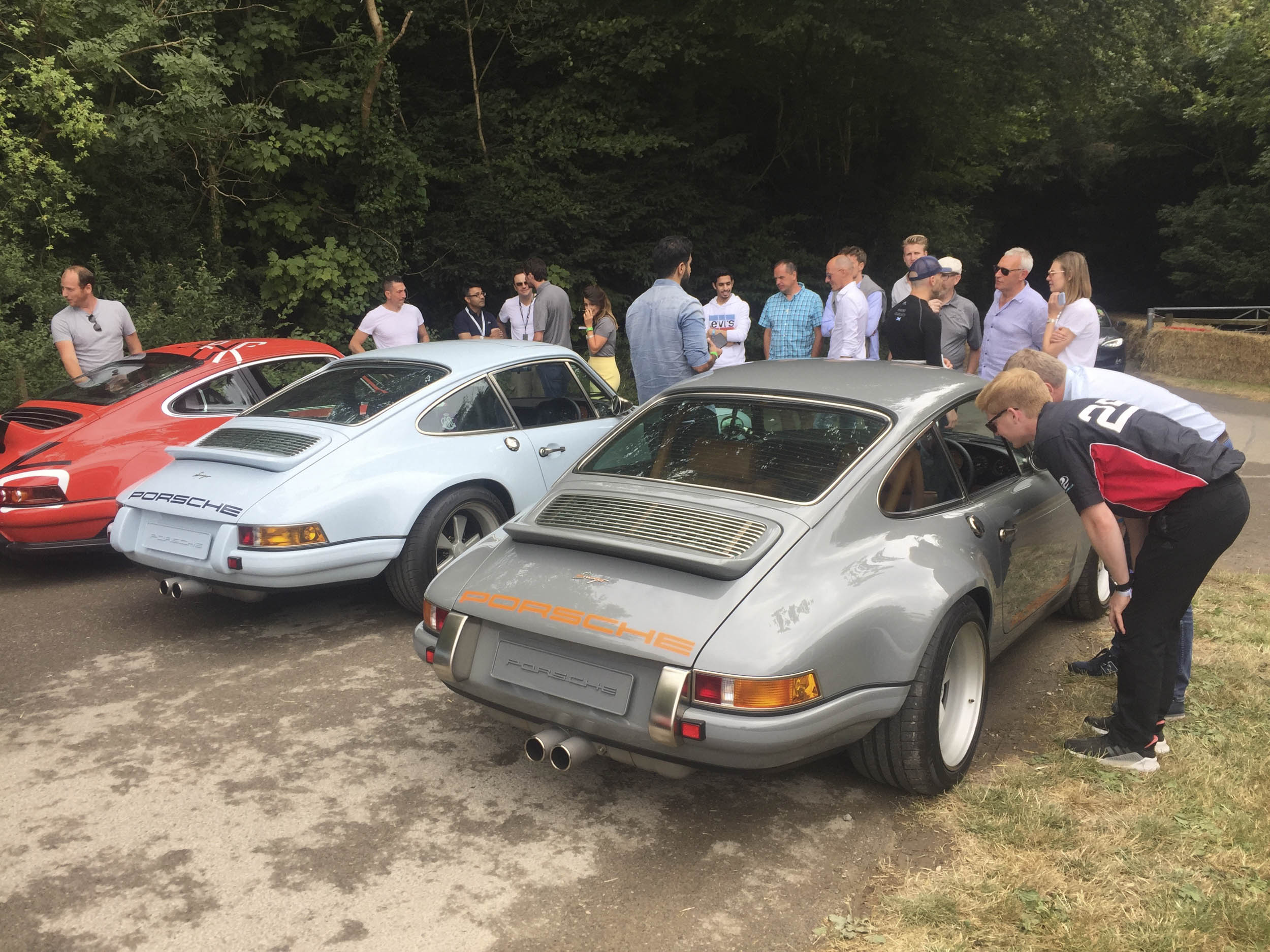 spectators looking at cars at goodwood festival of speed