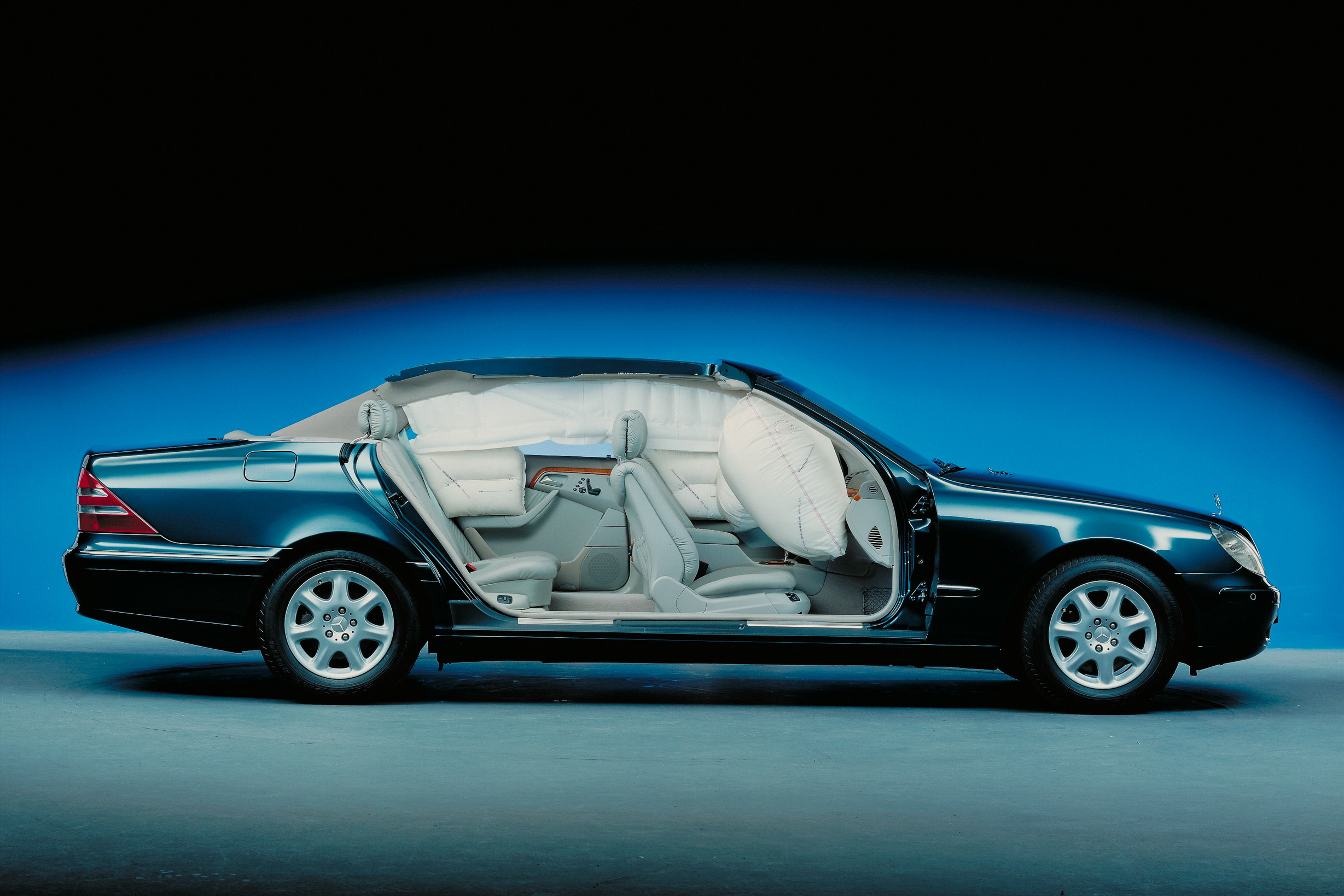 The Mercedes-Benz S-Class 220 made its debut in 1998 equipped with eight standard airbags including newly developed rear side window airbags.