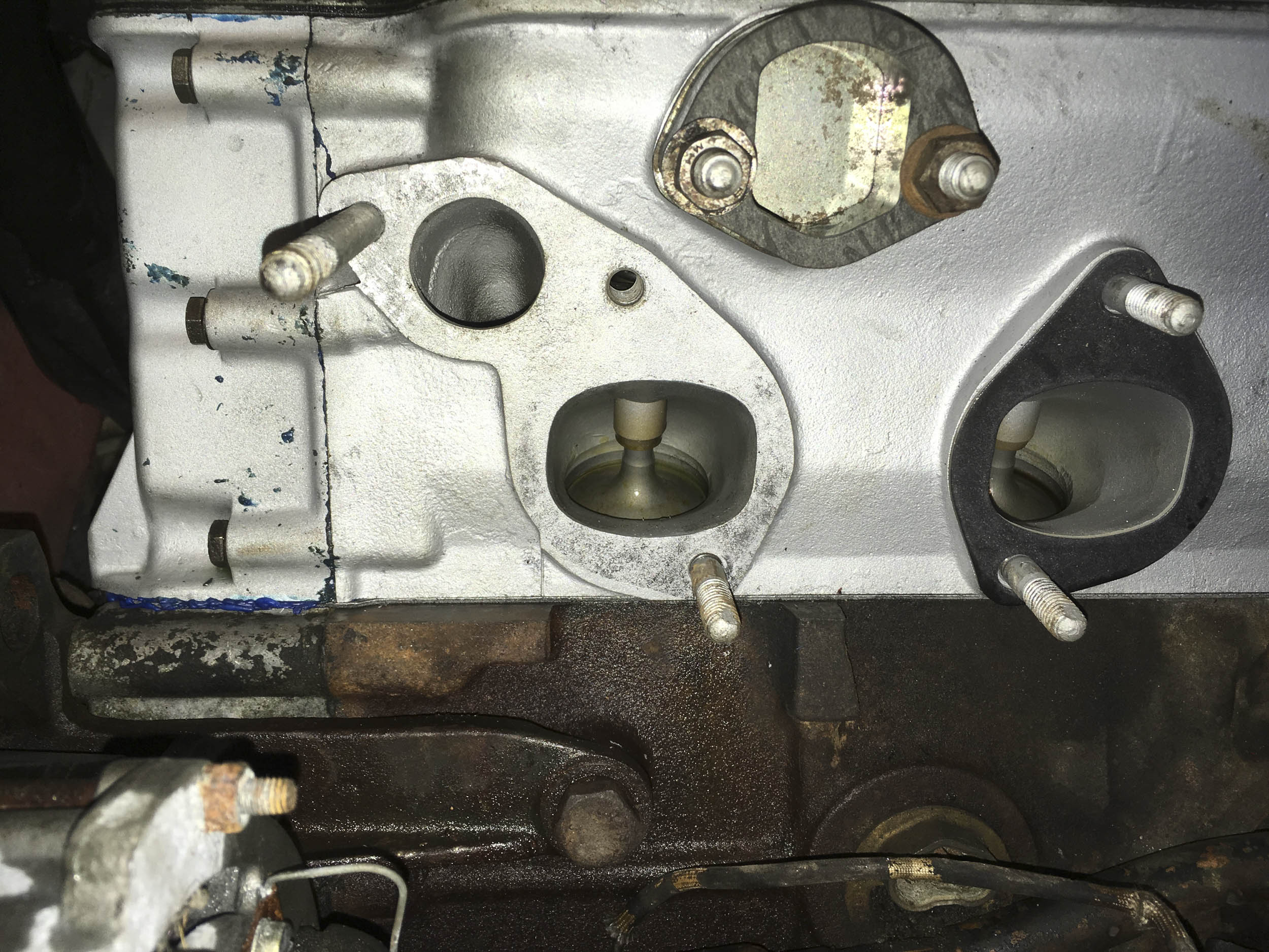 The gasket in this section needs to seal the coolant passage at the upper left. It was removed, coated with gasket sealant, and reinstalled.