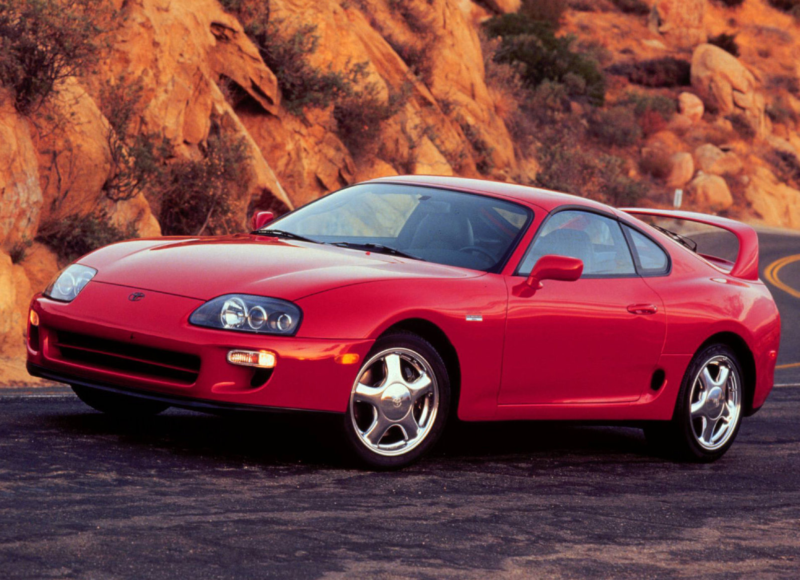 1996 Toyota Supra front 3/4 red canyon stock