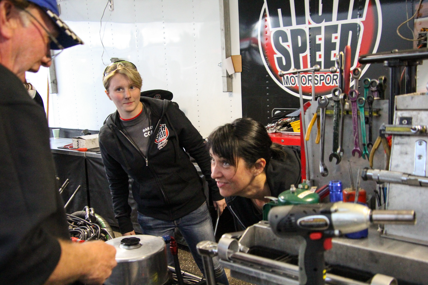 High-Speed Motorsports owner and Crew Chief Tom Shelar, then Top Fuel Intern Alanna Kuhn, and driver Mendy Fry in the pits at the Bakersfield March Meet.
