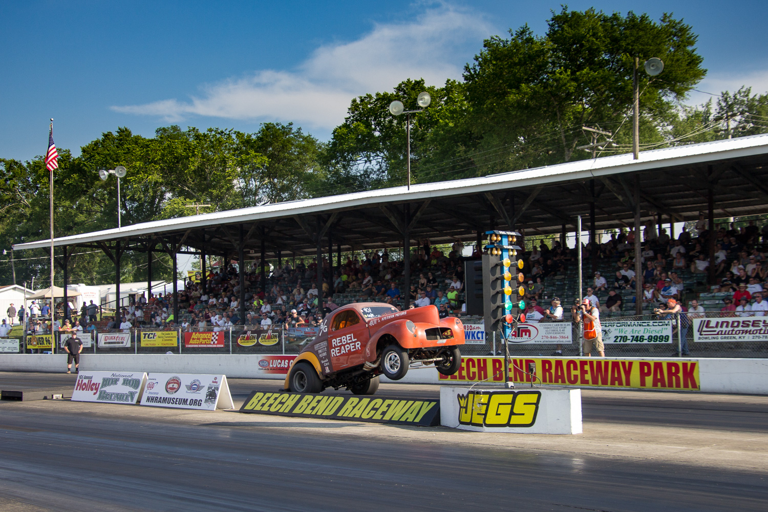 Geezer Gassers event winner Don Moyer hangs up the front wheels in his AMC 401-powered Rebel Reaper gasser.