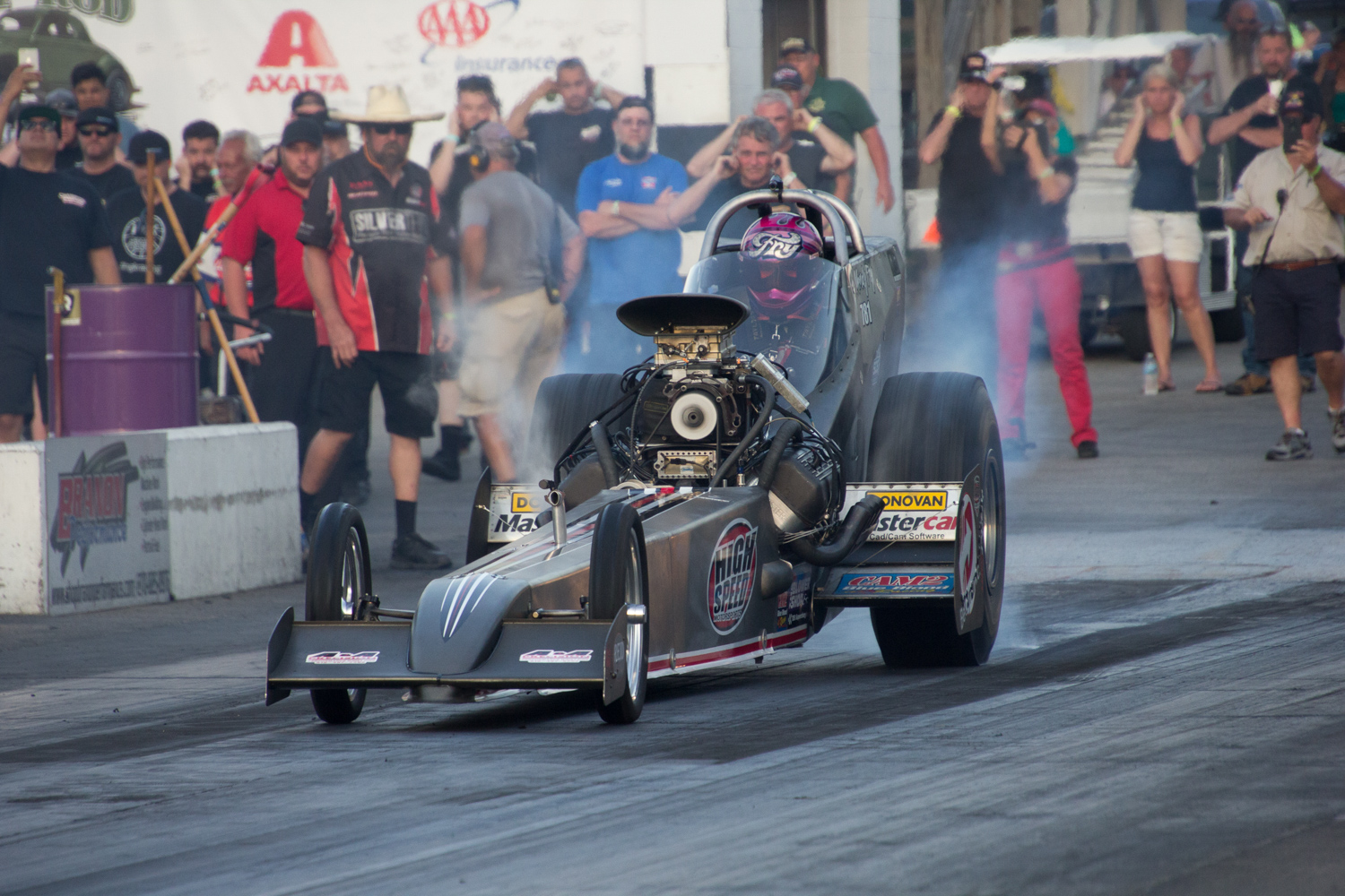 Mendy Fry heats up the tires in the High-Speed Motorsports dragster.