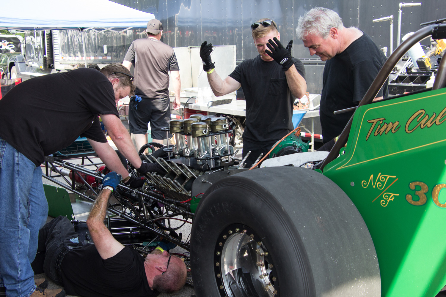 Tim Cullinan and son tear down the hemi in between rounds at Beech Bend.
