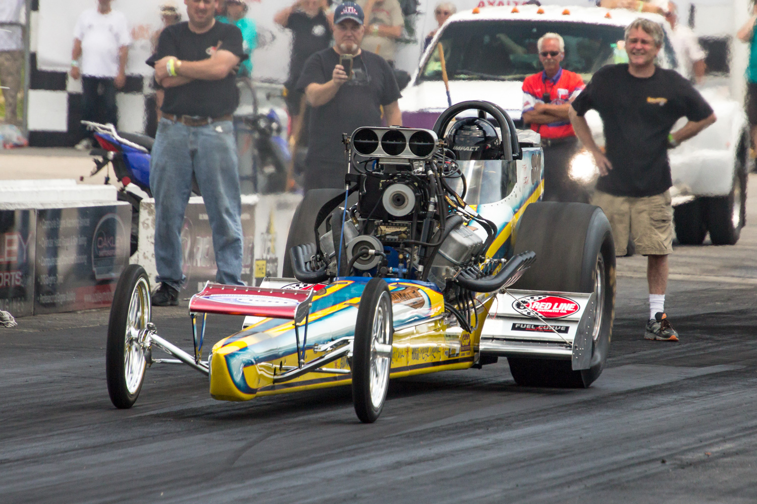 Tyler Hilton launches the Great Expectations III Top Fuel dragster off the line as his Dad Robert reads the run.