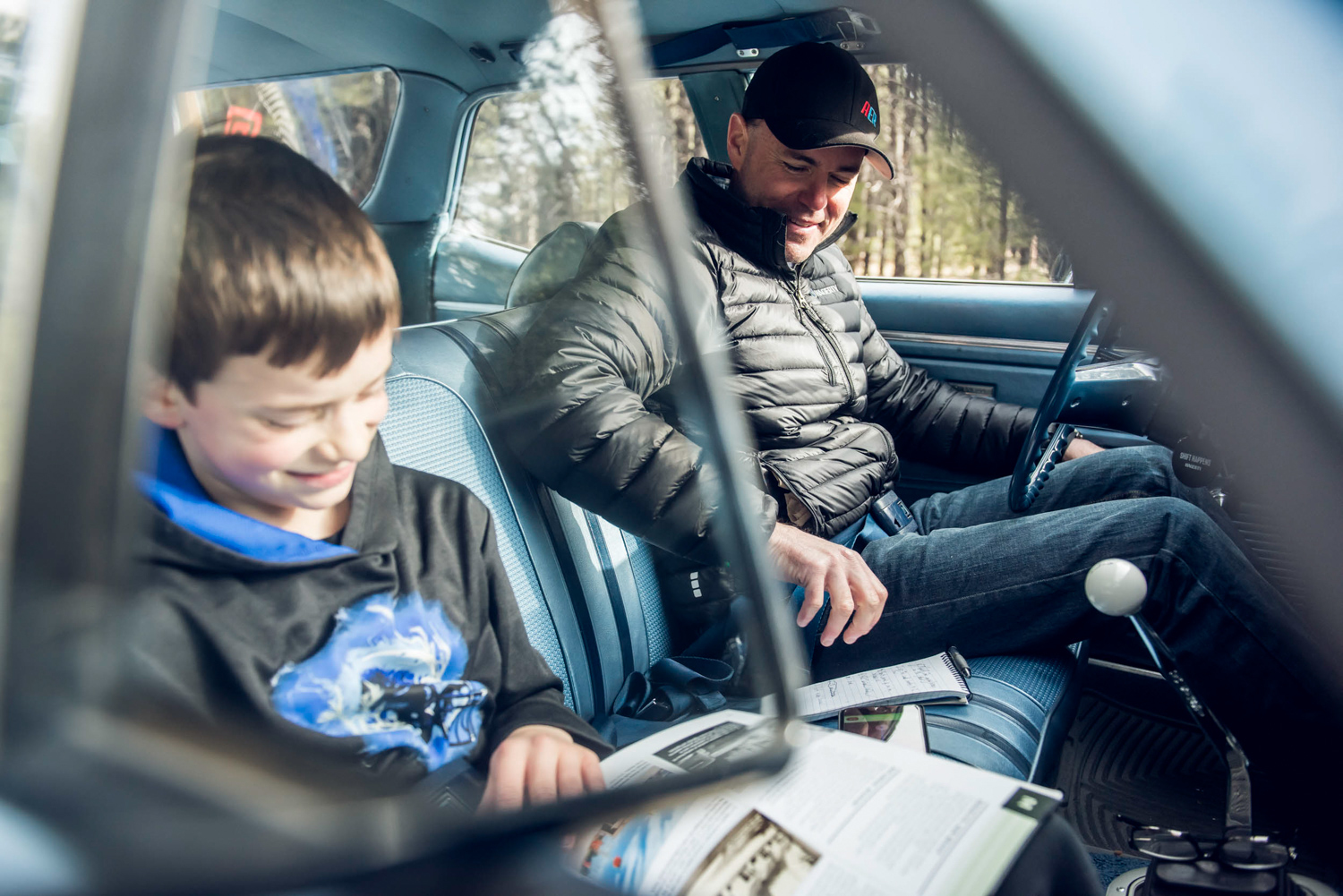 Nine-year-old Sam Webster, left, came up with the idea for the Route 66 family road trip and is evidence that kids still love cars.