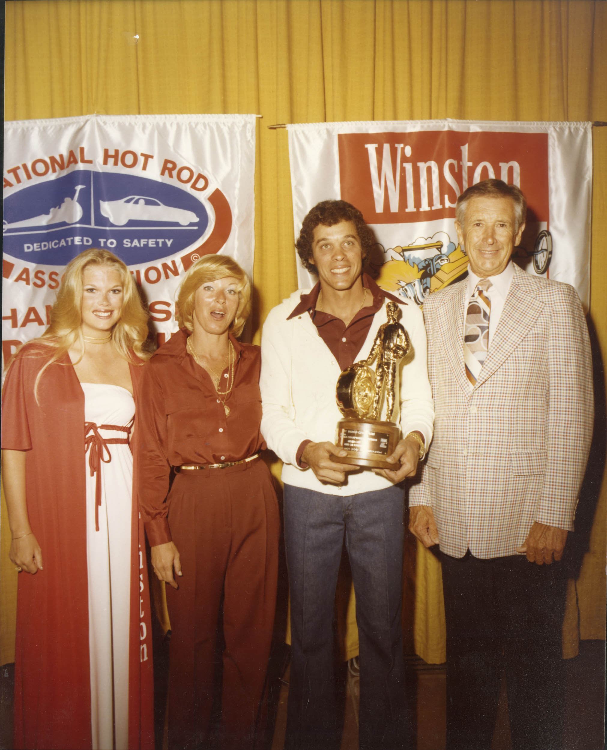 """Left to right, 1977: Miss Winston; Lynn and Don Prudhomme; NHRA founder Wally Parks. Between 1975 and '78 Prudhomme won four consecutive championships. """"I couldn't have done this without my wife, Lynn,"""" he says. """"She had the brains and I had the balls."""""""