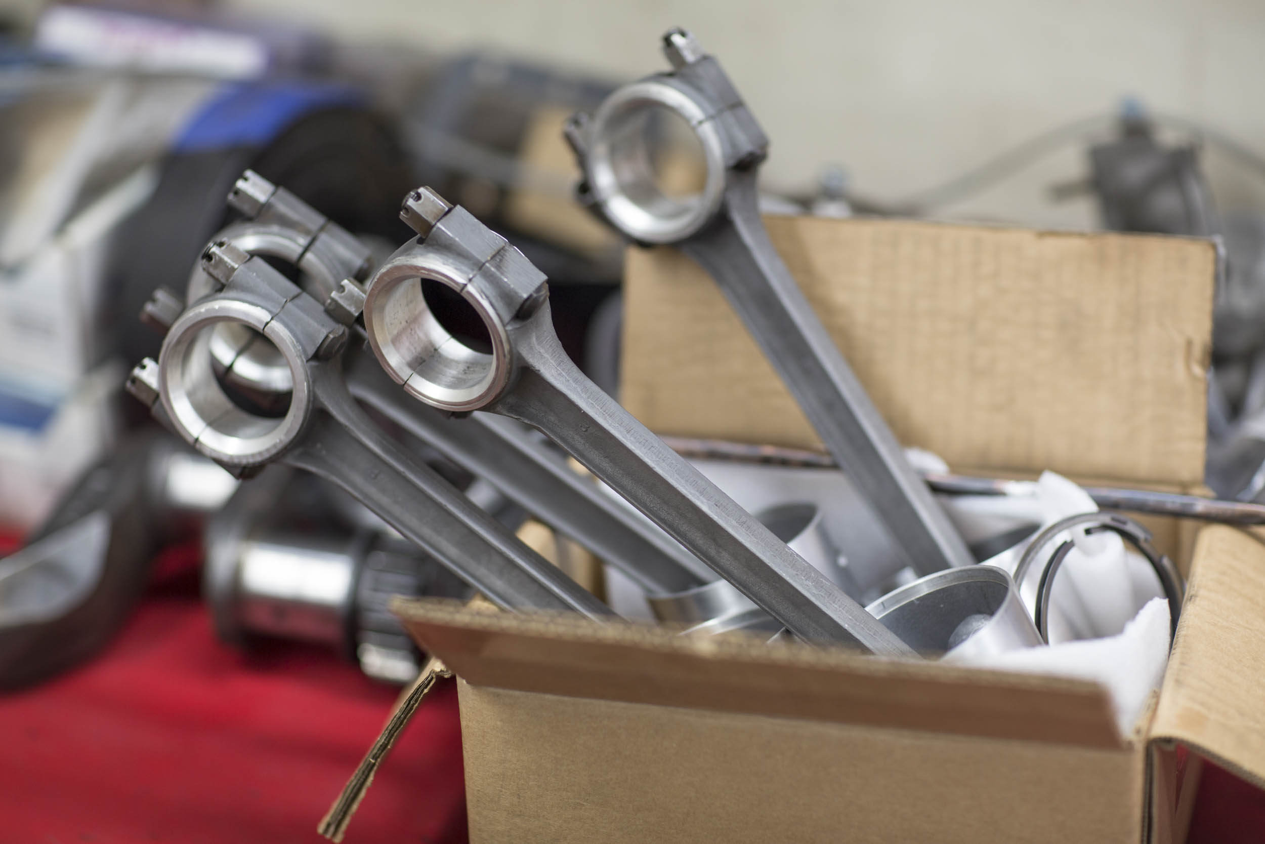 a set of Ferrari pistons and rods await their new home.