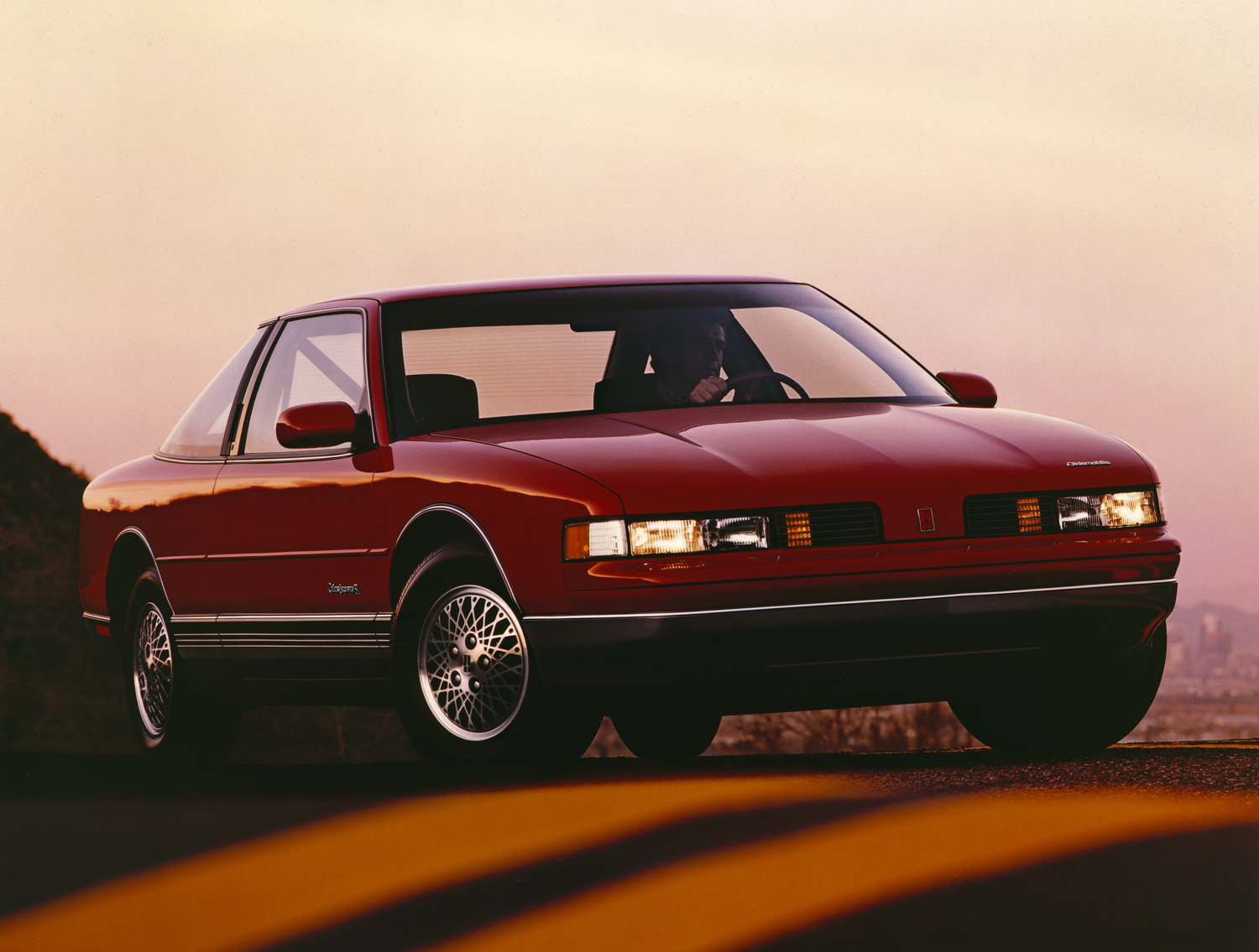 1989 Oldsmobile Cutlass Supreme front 3/4 red