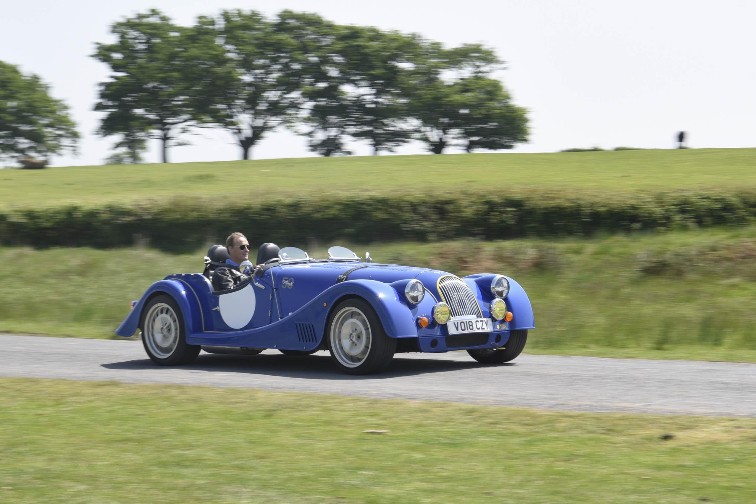 blue Morgan Plus 8 driving