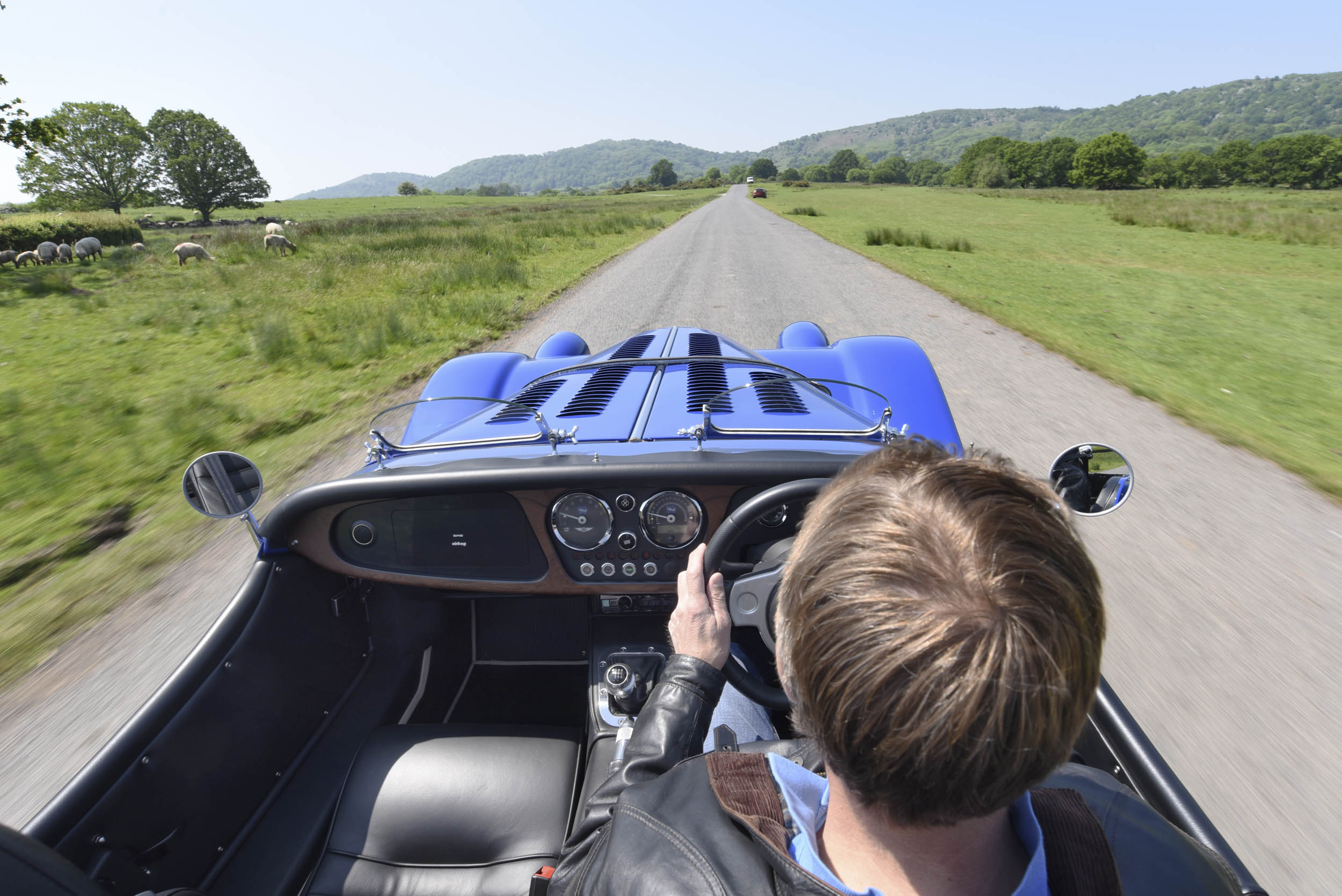 behind the wheel of a Morgan Plus 8