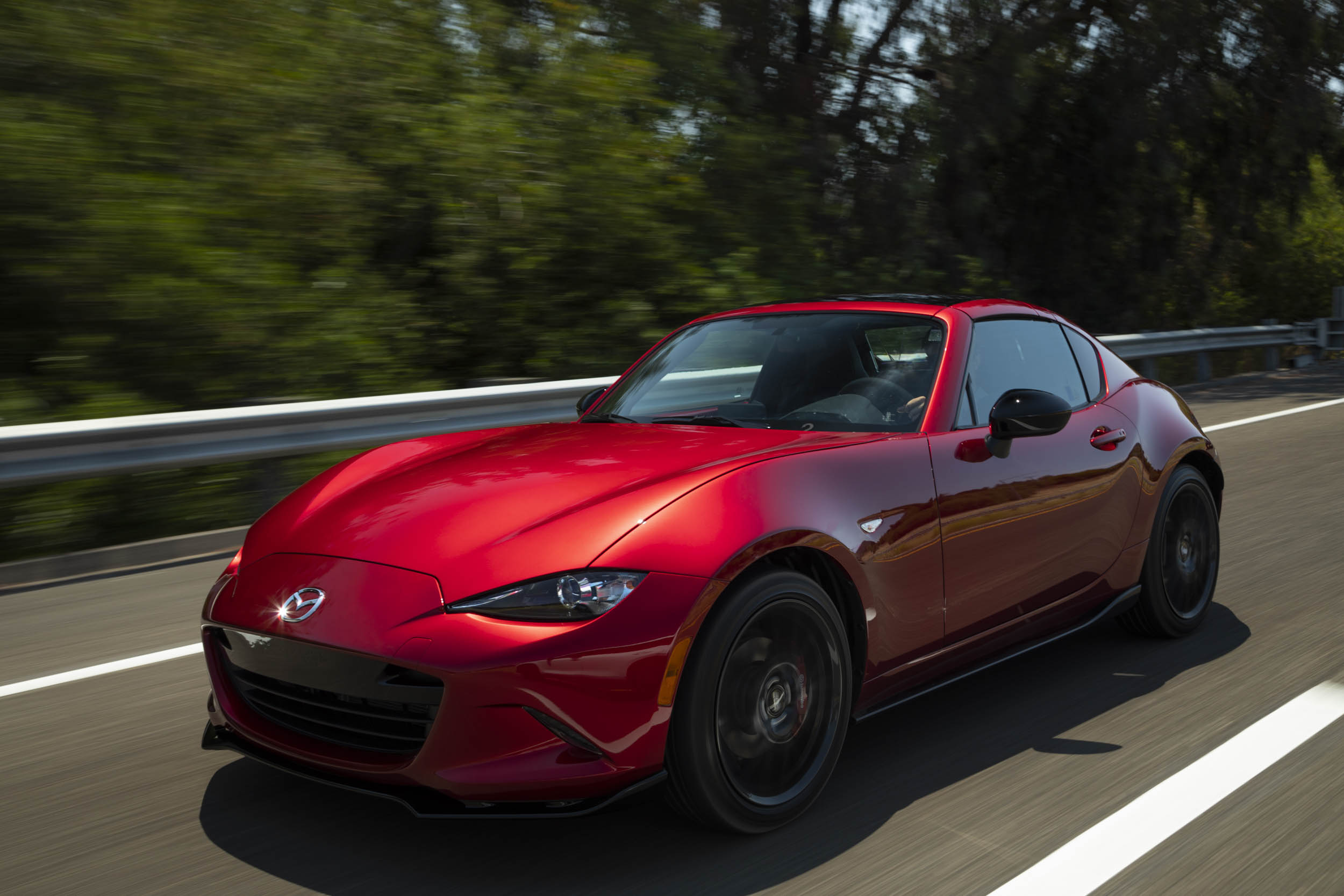 Red 2019 Mazda MX-5 Miata Roadster drving