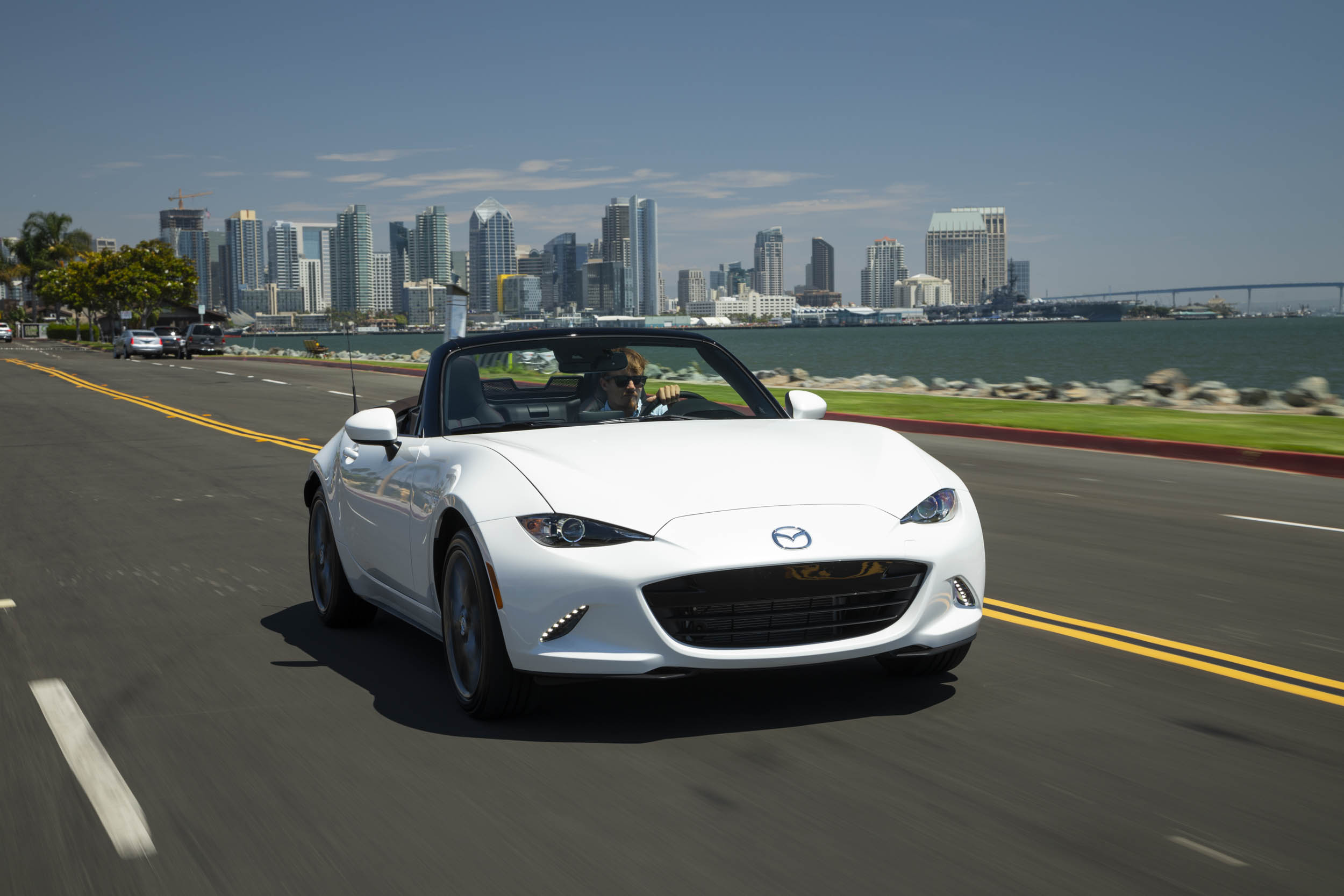 driving with the top down 2019 Mazda MX-5 Miata Roadster