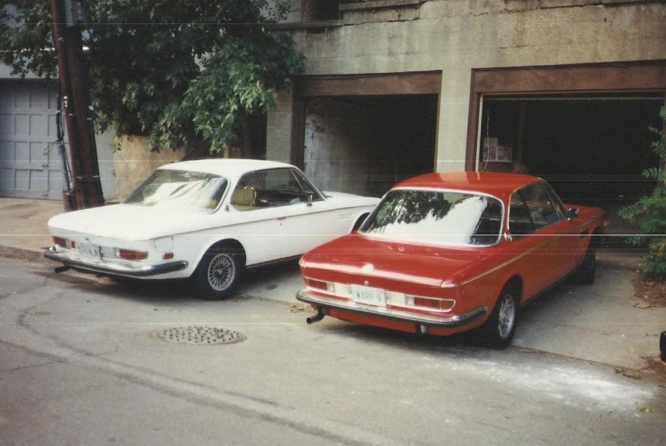 The red and white E9s. You can see the tan leather interior in the white car that eventually went into the red one.