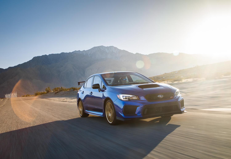 Subaru WRX STI Type RA rally blue wheels mountains
