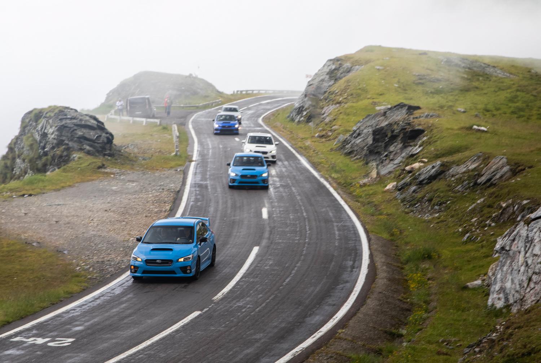 Subaru WRX STI Type RA passing on mountain road
