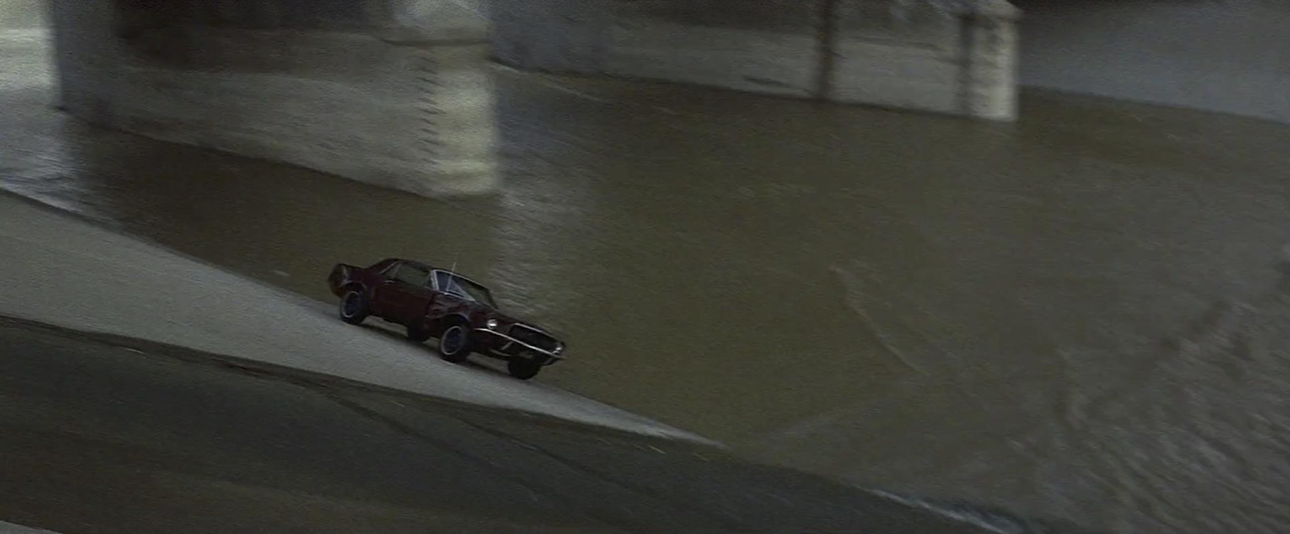 mustang driving along the LA River