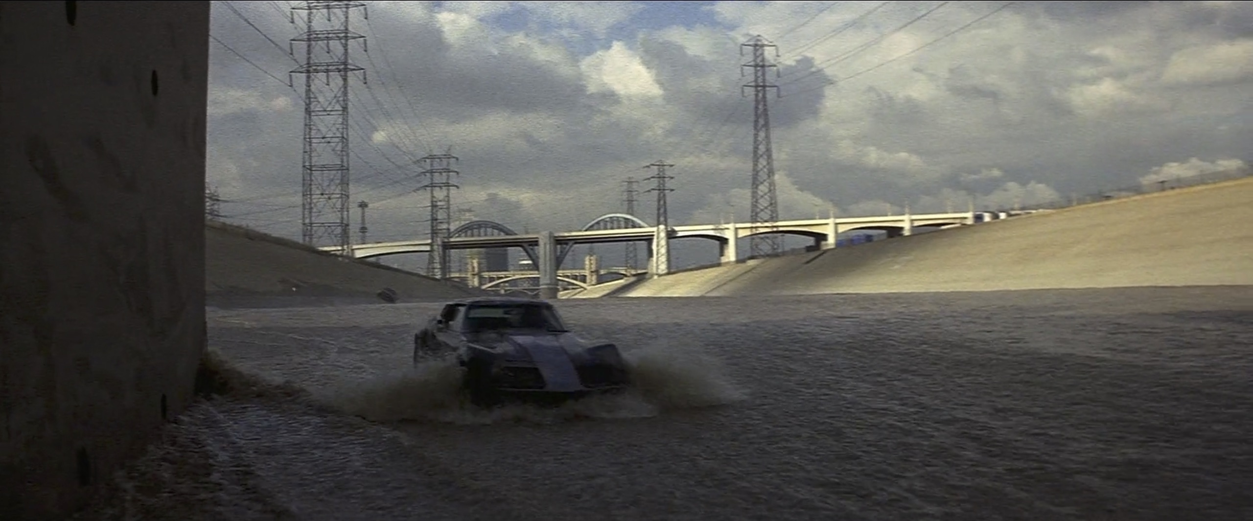 corvette splashing through the LA River