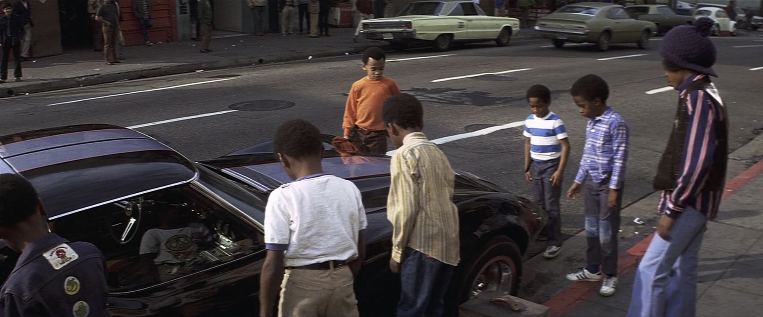kids checking out Cleopatra Jones Chevy Corvette