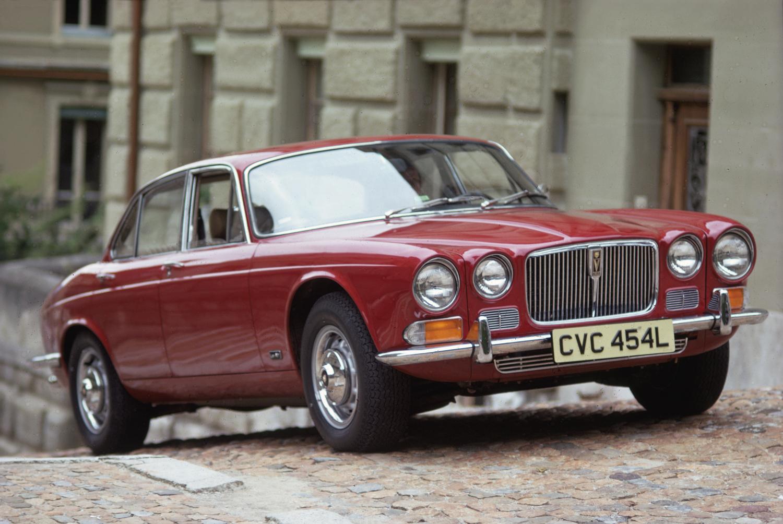 1973 Jaguar XJ6 red city street