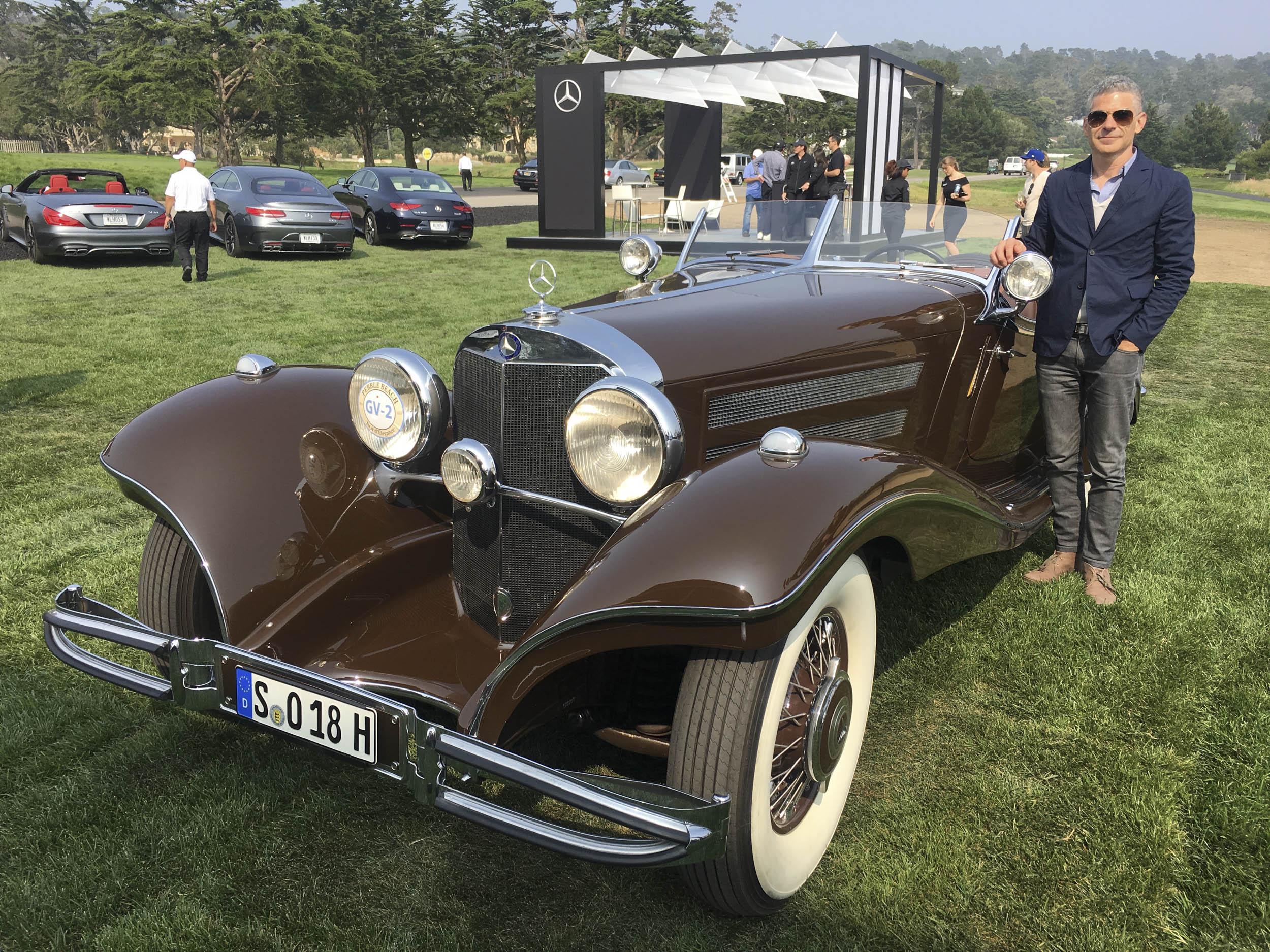 Brett Berk standing next to a 1935 Mercedes-Benz 540K