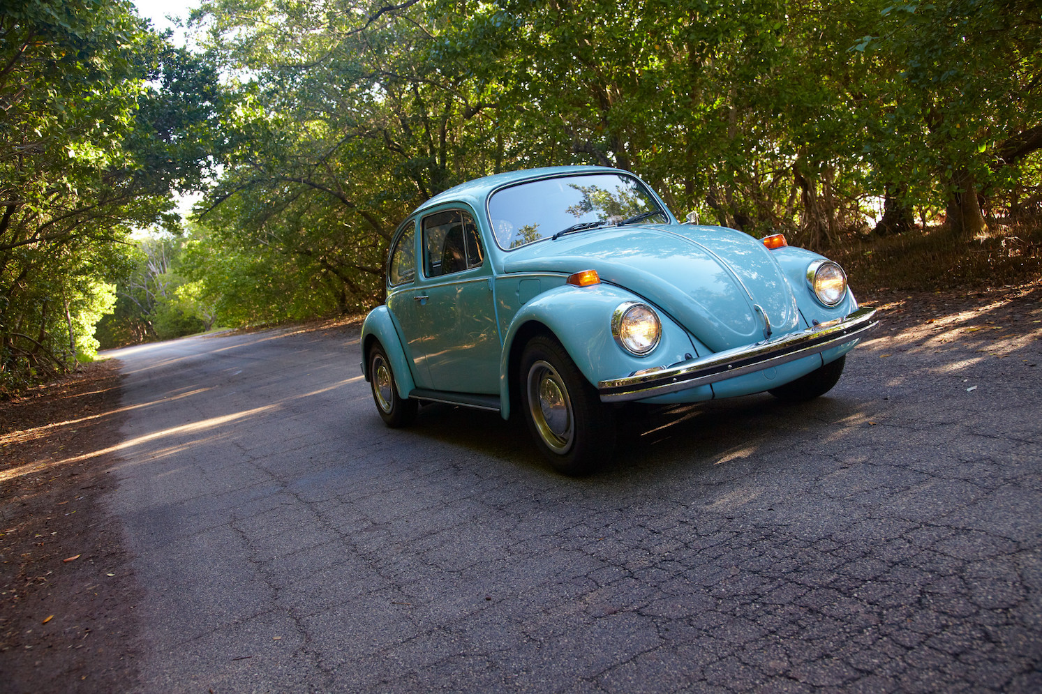 1973 Volkswagen Beetle blue driving shot