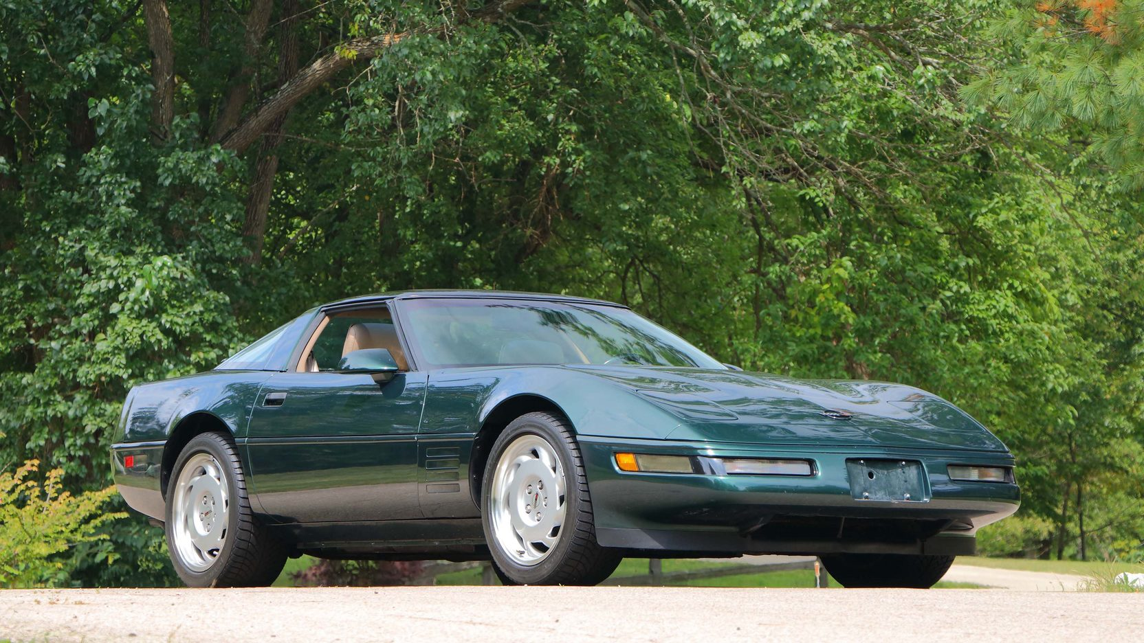 1992 Chevrolet Corvette green over tan 3/4 front