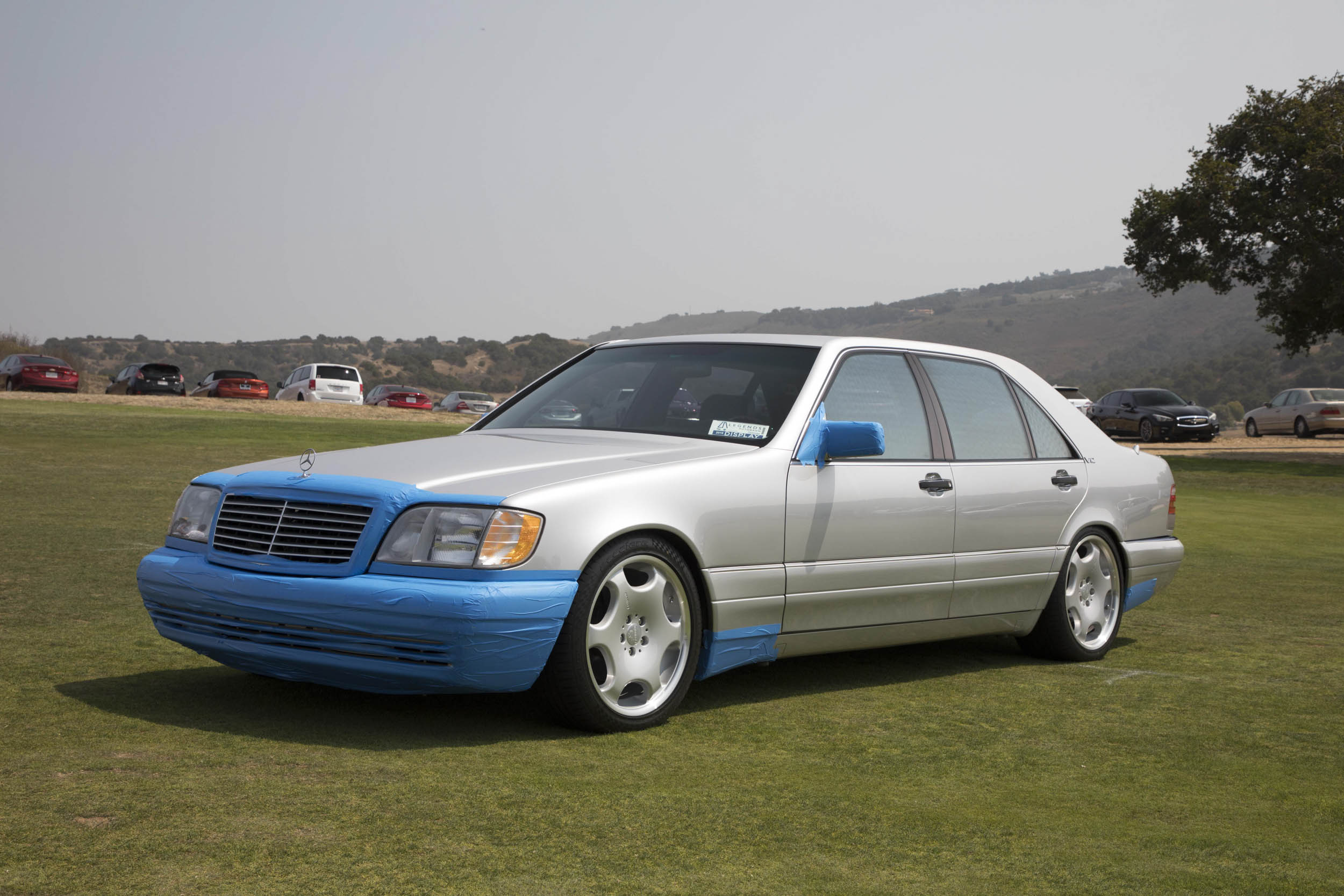 "We came across this immaculate 1995 Mercedes-Benz S600 V-12 just as owner Nover Reniedo was starting to apply blue painters tape to the sedan's frontal area for the drive back home to Torrance, California (near Los Angeles). His efforts have been worth it during the 15 years he's owned the car, as the exterior is flawless. ""If you maintain your car daily, it never gets ahead of you,"" Nover told us, ""and it doesn't take that much work to keep it perfect."" The interior of the big Benz is just as pristine. Nover told us he keeps the leather butter-soft by applying a layer of neatsfoot oil covered in plastic garbage bags for three days. ""It smells at first,"" he admits, ""but it goes away!"""