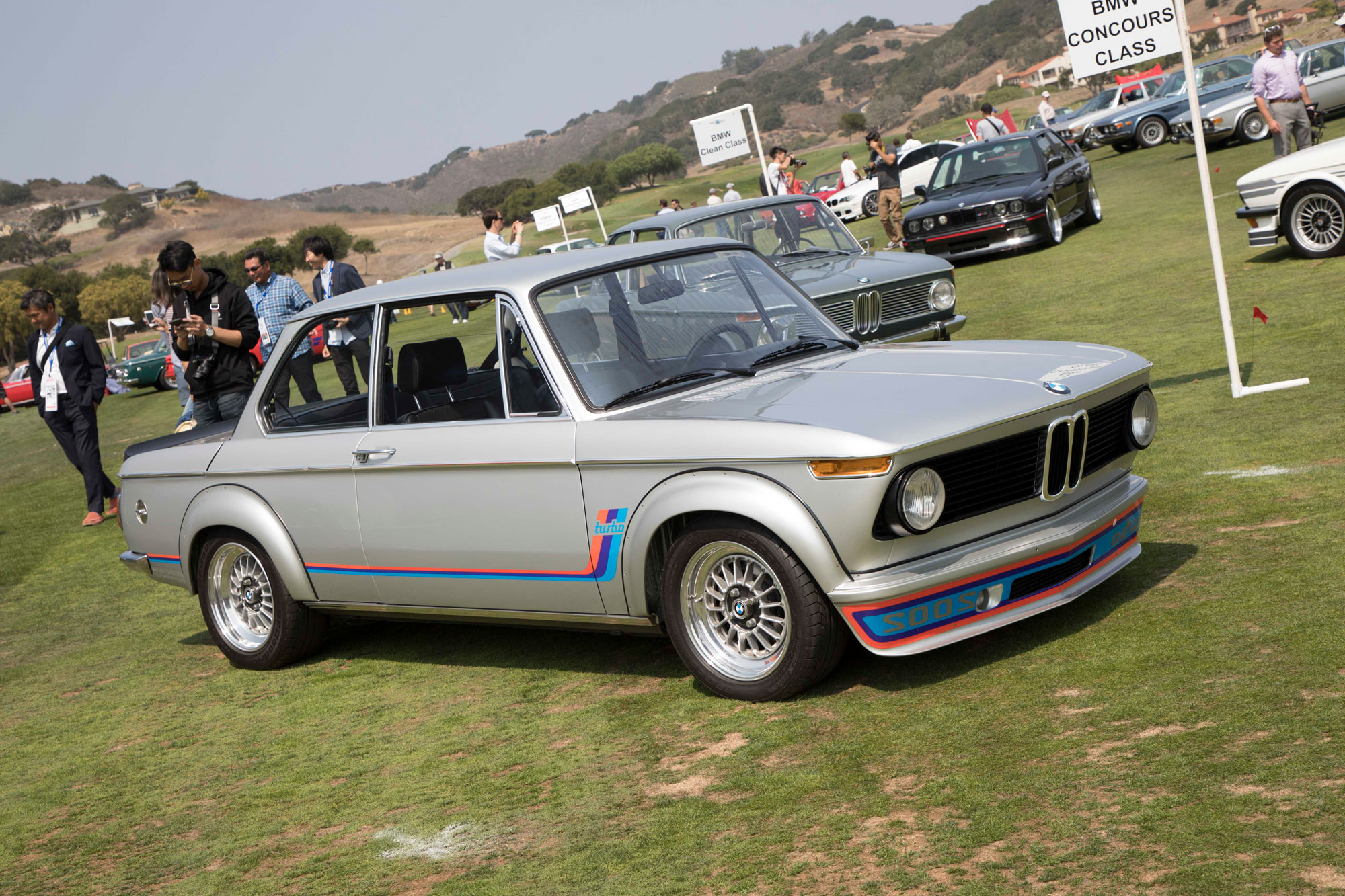 The 2002 Turbo was BMW's first production turbocharged car and a case study in turbo lag. This well-preserved car is owned by Joe Cervantes and took first place in the BMW Concours class. The reverse script on the front bumper was there, of course, so drivers of other cars could read it in their rearview mirrors and get out of the way. A KKK turbocharger upped the stock 2002tii's output from 130 horsepower to 170, big numbers back in 1974.
