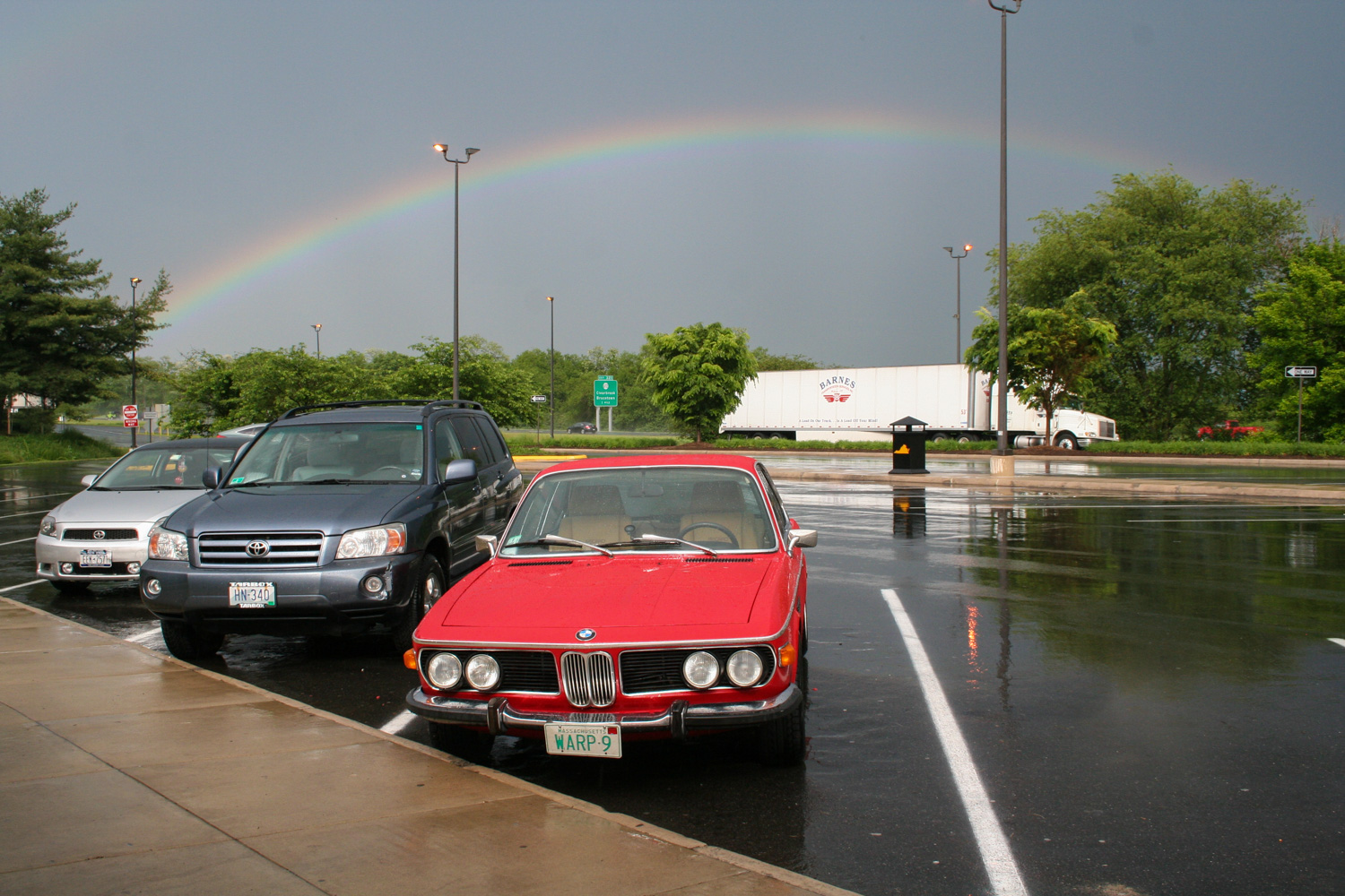 A brief rainbow-punctuated respite during The Great Drenching Event of 2013. BMW