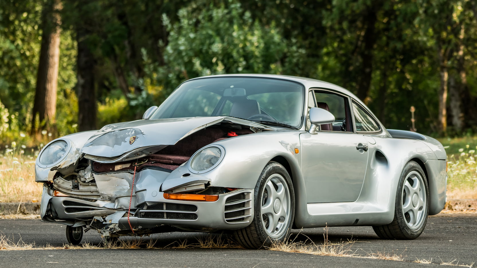 Smashed in transit, this Porsche 959 still sold for $467,500 thumbnail