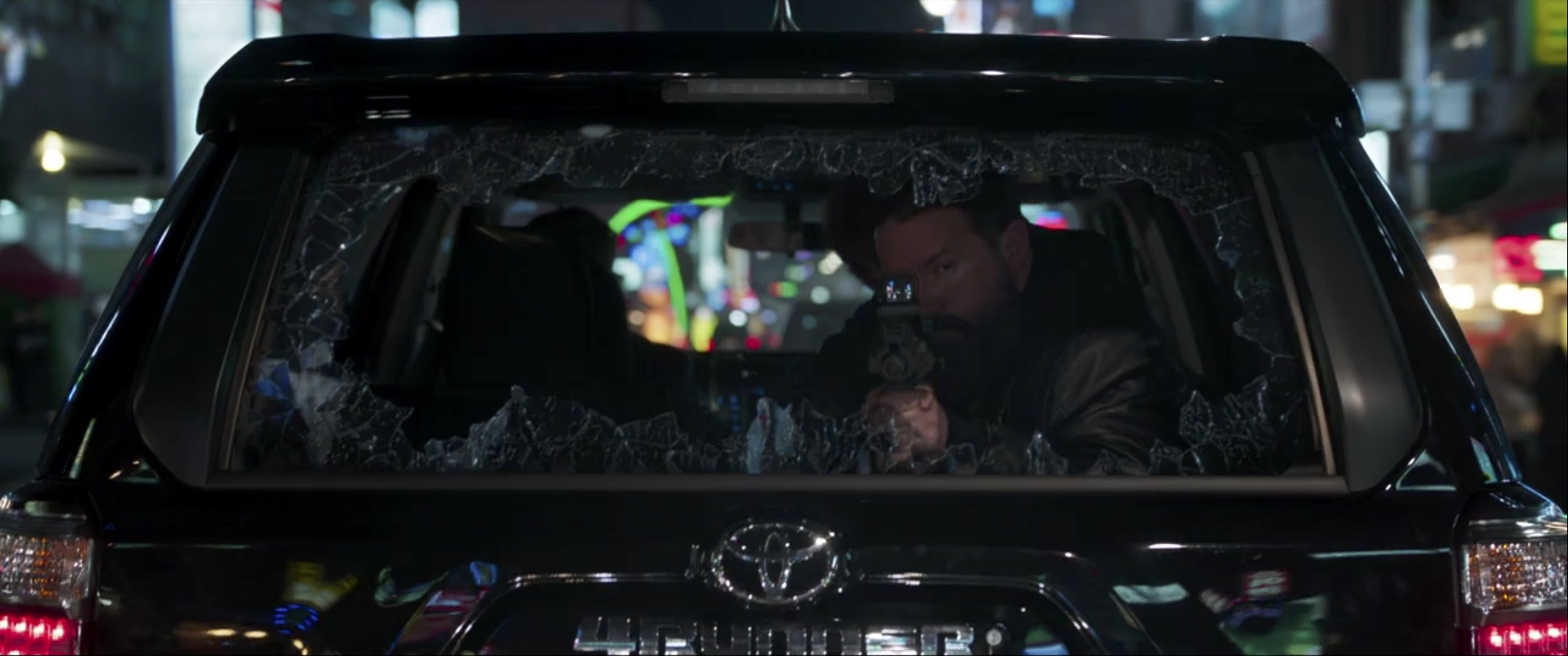 Marvel Black Panther shooting from rear window