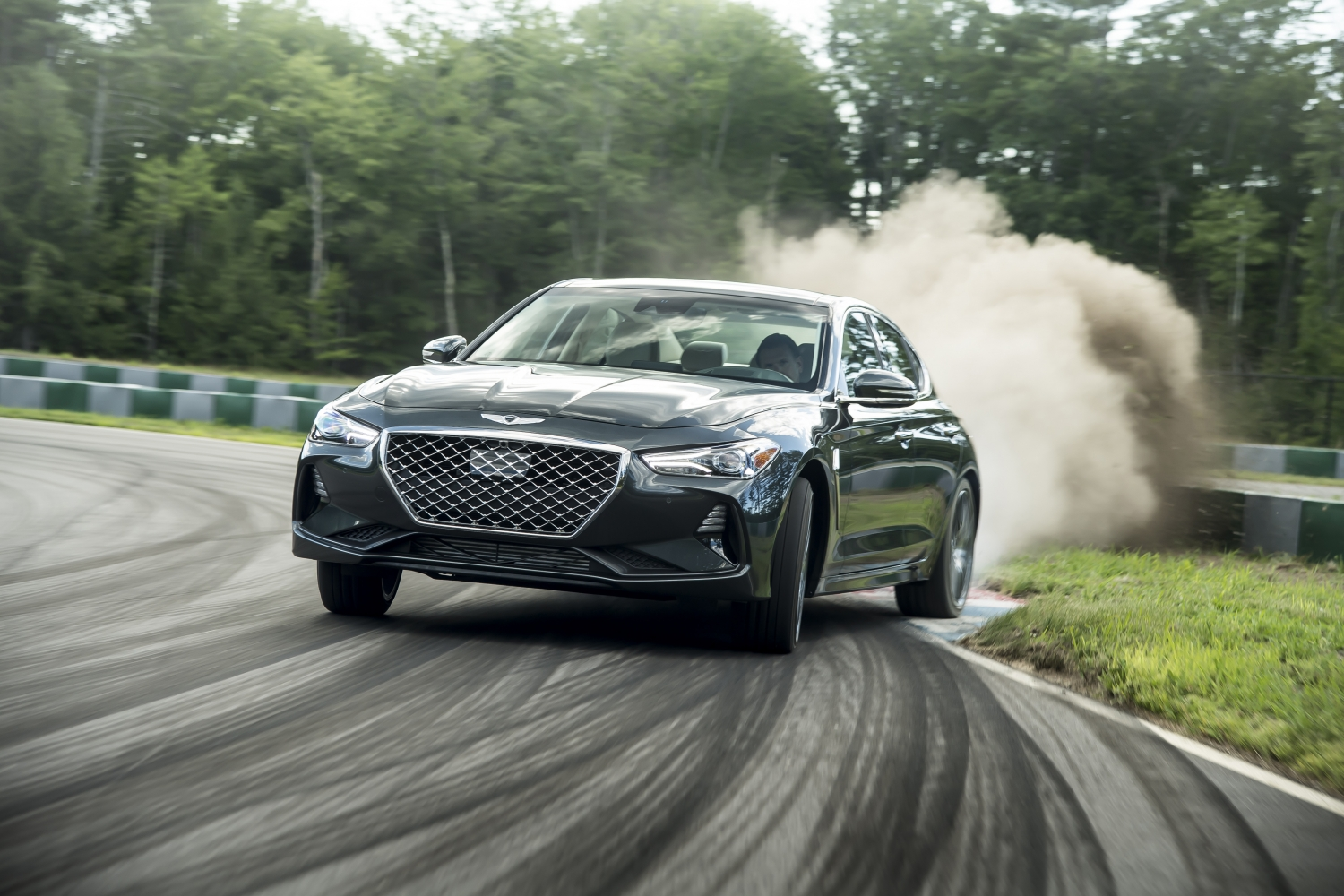 2019 Genesis G70 dust kicked up on track