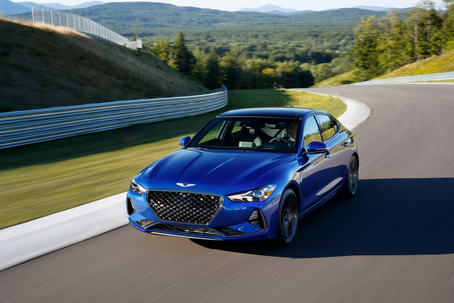 2019 Genesis G70 blue on track high 3/4