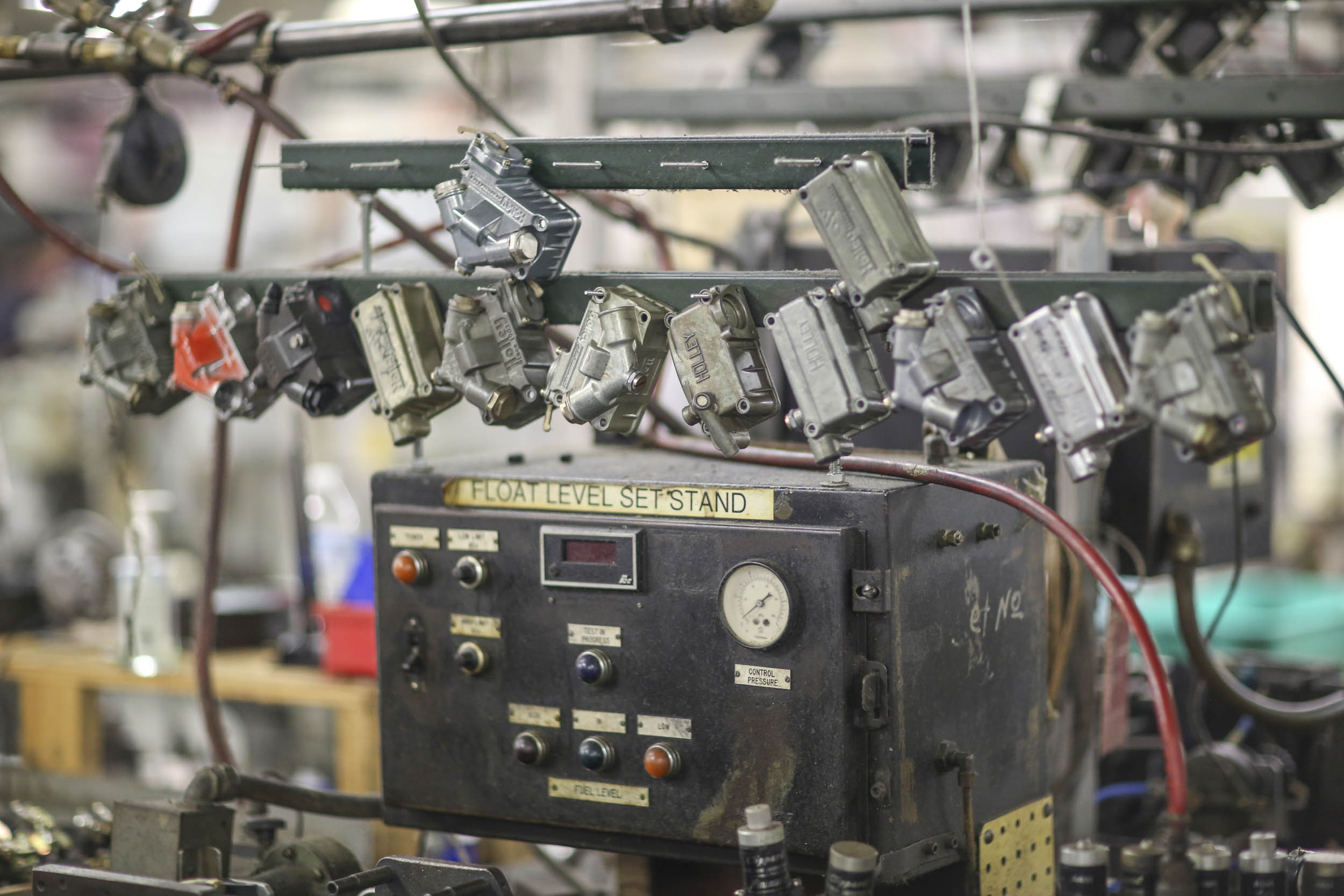 A fuel bowl from each carburetor built on the line is on hand to act as a standard for testing