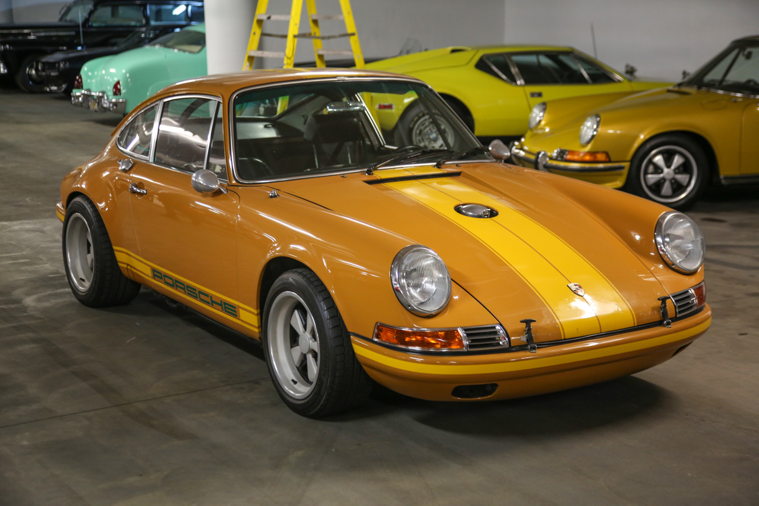 "This 1969 911E, known as the ""Brown Bomber,"" was restored by Rob Dickinson in Los Angeles and became the genesis of the reimagined 911 models restored and modified by Singer."